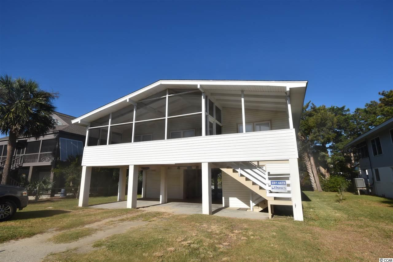 This charming, classic Pawleys Island creek house, is a great gathering place for friends and family, with lots of bedrooms and the creek to play in. Bring the boat, paddle boards and the kayaks. 620 feet to the beach, not just the access, actually to the beach!  Beautiful wood floors throughout the main floor, tile on the first floor, all baths and kitchen. Lots of solid oak kitchen cabinets and solid core counter top. New living room furniture, sliding glass door, refrigerator, patio furniture and  A/C unit in 2018. Outside shower, fish cleaning station and floating dock.
