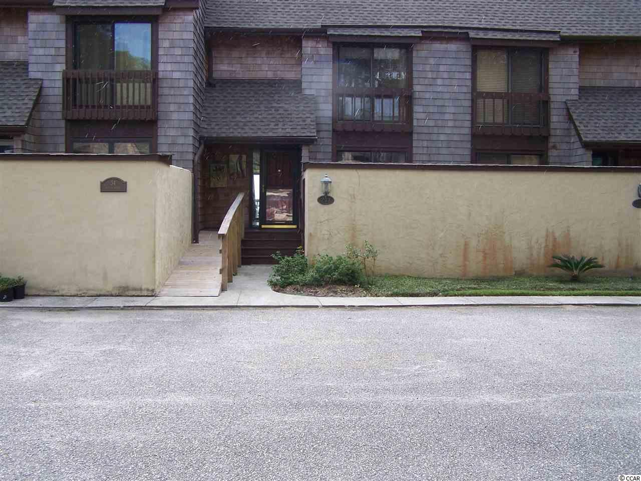 Hidden gated community on Winyah Bay and the Intracoastal Waterway. Great 2 bedroom 2 and 1/2 bath unit with views of the bay and Lake Johnstone.  Unit has recently been renovated new hardwood floors and paint and is ready for a new owner. Belle Isle amenities in 2 pools, tennis courts, Yacht Club, marina, and private gated beach house on Pawleys Island