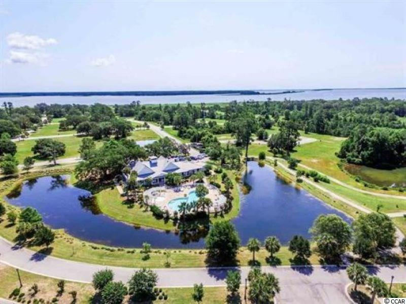 HUGE PRICEW REDUCTION!!!  South Island Plantation...A gated community located along Winyah Bay and the Intracoastal Waterway, near Historic Georgetown, SC.  Community amenities include a pool, kiddie pool and hot tub. There is also a 5000 sq ft club house with an equipped fitness center, a bar and a full kitchen.  Walking trails wind throughout the community with gazebos for periodic resting. A fishing/crabbin' gazebo is  now complete.  A secured RV/ Boat storage area is available for property owners.  Huge oaks and beautiful ponds make this one of the premier communities in the area.  Build your dream home today.