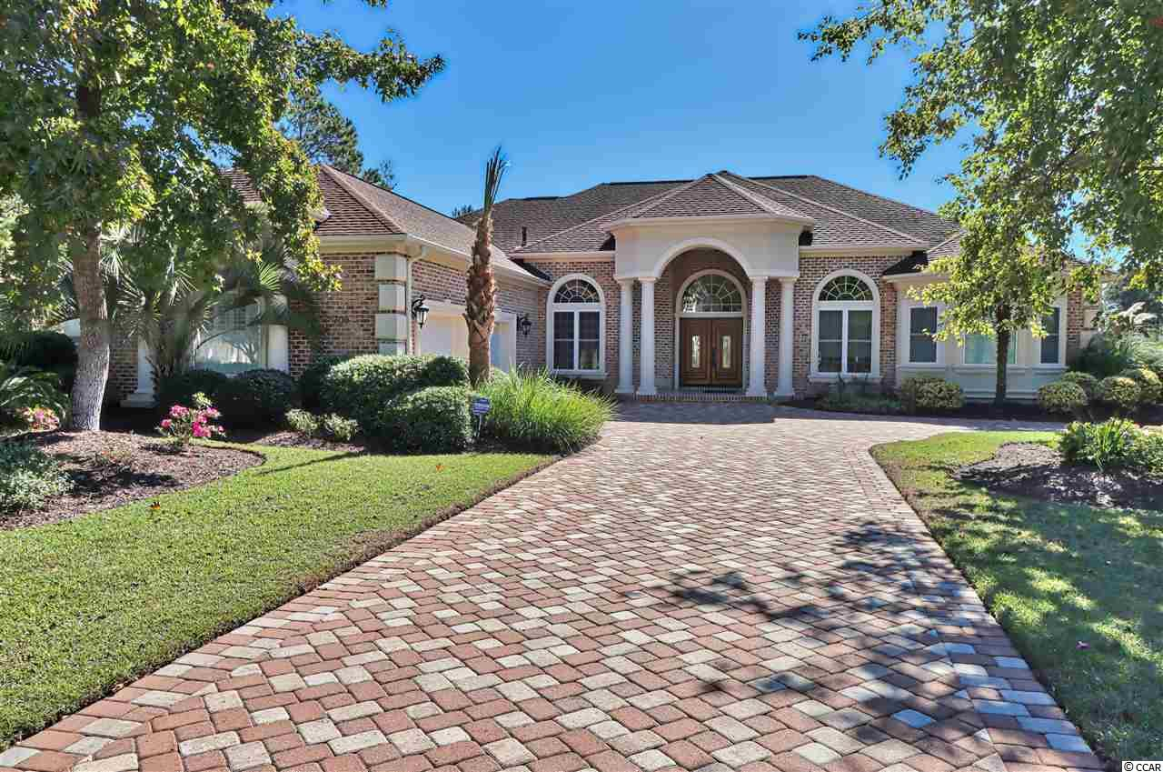 This beautiful, one level, 3br/2.5 bath home with an office, heated pool and spa, and an oversized garage offers panoramic views of one of the largest parts of the lake within the very desirable community of Plantation Lakes.   From the moment you step into the foyer, you are greeted with quality and details you don't often see.    Make sure you take note of the details in this awesome home such as single and double tray ceilings with rope lighting, crown molding throughout the entire home, ceramic tile and wood floors, granite anywhere there is counter space, custom wood shelving in all closets, and surround sound.    Once you enter this great home, you will walk into a 24 x 19 formal living room with custom ceilings and a grand gas fireplace.   This spacious living room offers incredible views over the pool and lake.   As you make your way into the spacious kitchen, you are met with granite counters, custom cabinets, large work island, gas range, tons of counter and cabinet space, butler's pantry, and a built in desk.   The kitchen opens up very nicely to a 20 x 17 family room/keeping room and to a spacious breakfast nook....with all of these rooms taking full advantage of the gorgeous lake views.   If you are someone who enjoys cooking and enjoys family meals, you will love the 14 x 12 dining room just off of the kitchen.    If working at home is important to you, the custom 14 x 12 private office will allow you to spend more time at home while working.   The great home also offers a split bedroom plan for total privacy.   The master suite offers gorgeous lake views as well, and his and her closets with both of them being identical and very large.   The master bath boasts double sinks with granite counters,  whirlpool tub, and a spacious tiled walk-in shower with two shower heads and additional jets.    Both additional 14 x 12 guest bedrooms are on the opposite side of the home and both have custom closets as well.    If you prefer being outdoors, you will love t