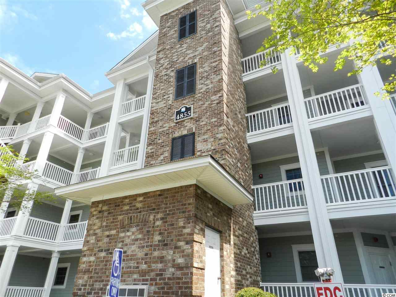 A spacious 3Bed/2Bath END UNIT Condo in Magnolia Pointe - an elevator building in a beautiful, well planned and superbly managed golf course community delivering easy living in Myrtle Beach. Freshly painted walls! Open concept & spacious with a large balcony and panoramic views of the pond, fountain and green space!  All rooms are centered around the large, open kitchen. Relax and enjoy oversized rooms, a split bedroom floorplan, end unit windows and the peaceful balcony.  This unit has been well maintained and would be perfect as a primary residence, short term or long term rental. Multiple pools, walking trails, lush landscaping, palms & flowering shrubs fill the common areas at Magnolia Pointe. So, so close to everything –  Close to Hwy 17 Bypass, Hwy 17 Business, Hwy 31, Hwy 501, Shopping, Dining, Entertainment, Medical, Recreation & a golf cart ride to the beach!