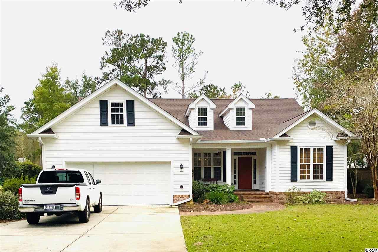 Lovely 3 bedroom 2 bath  home located in the heart of Pawleys Island in a sought after relaxed community of Hagley Estates with no HOA.  Home sits on over 1/2 acre of land with beautiful mature landscaping and trees. The home backs up to a view of the 4th tee of the Founders Club golf course and also a pond view. A large open great room and formal dining with hardwood floors and trey ceilings and columns gives way to a open feel. From the great room, glass french doors open up to a cozy family room with vaulted ceilings and a fireplace. The large master bedroom with a walk in closet on a separate wing of the house. The master bath boosts double sink vanity, shower, and garden tub. The other two bedrooms share a full bath.  Kitchen features are granite counter tops and stainless steel appliances, a breakfast bar and breakfast nook. Walk out from the breakfast nook to enjoy  your all season screen porch and patio. Attached double garage and additional parking for boats,etc. Roof was replaced in 2019. HVAC replaced 2010.  There is an attached storage/workshop. This home is conveniently located just minutes from Pawleys Island/Litchfield beaches as well as the Hagley boat landing on the Waccamaw River. Schedule your showing today!