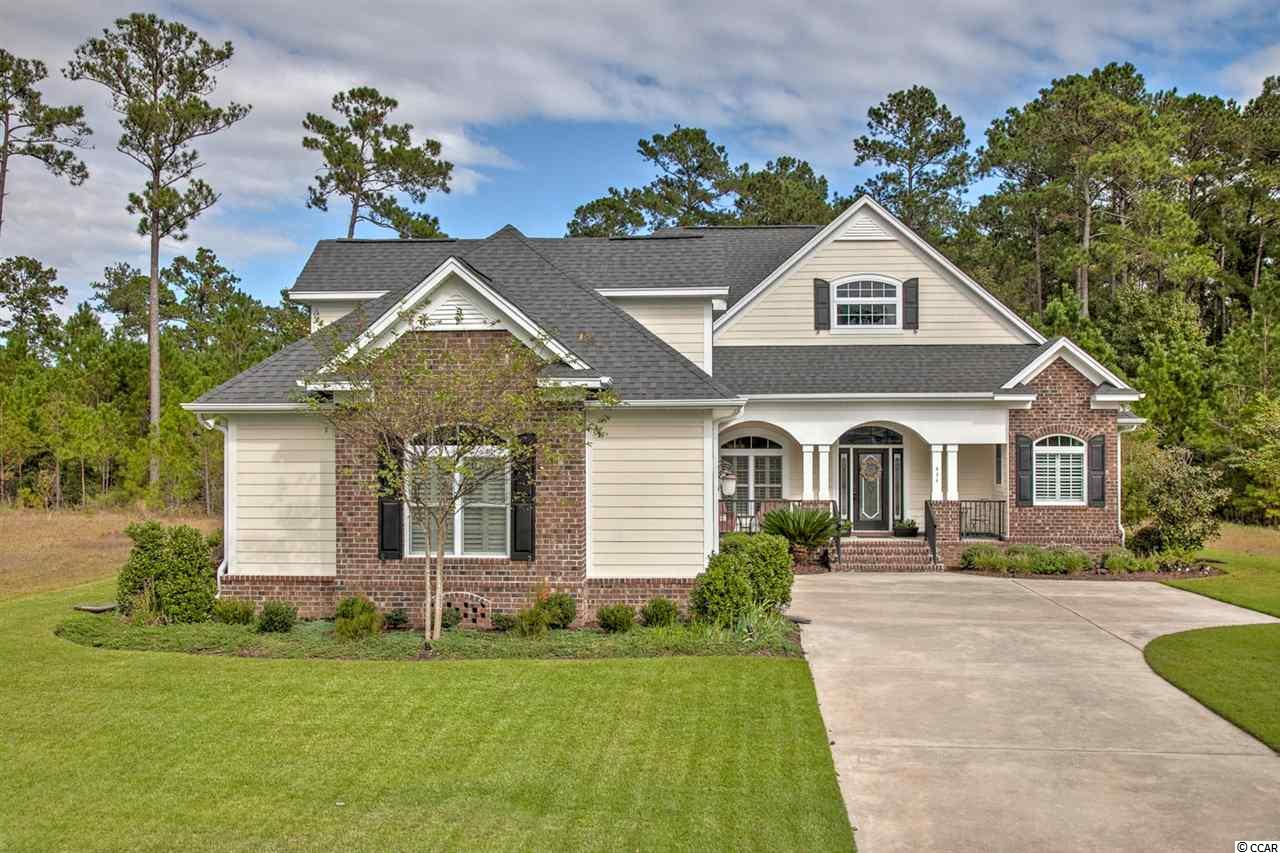 Southern Charm at its Finest! This IMMACULATE home offers an open floor design consisting of 4 bedrooms and 3 bathrooms with most of the living space on one single level. There are 3 bedrooms/2 bathrooms downstairs and 1 bedroom/bathroom upstairs. This home HAS IT ALL and contains MANY upgrades from Plantation Shutters throughout, Natural Gas for cooking, the Gas fireplace, Gas heat and Tankless Rinnai water heater, has an Oversized Garage, 2 kitchen Pantries, Soft-Close cabinetry throughout with roll out shelving, Attic Radiant Barrier System to help lower electric bills, Easy-Breeze windows in Carolina Room with Tile and Custom Shades, upgraded Landscape/Irrigation System and MUCH MORE! This gated community offers a pool, clubhouse, Nature Boardwalk, Deep Water Access Boat Ramp and Boat Storage space. Wind down after a long day at the beach or from the golf course on your large back patio enjoying the evening breezes as the leaves rustle in the mature landscape behind the home. This property is just under Half an Acre in sought after Collins Creek Landing of Prince Creek in beautiful Murrells Inlet, SC. It won't last long!