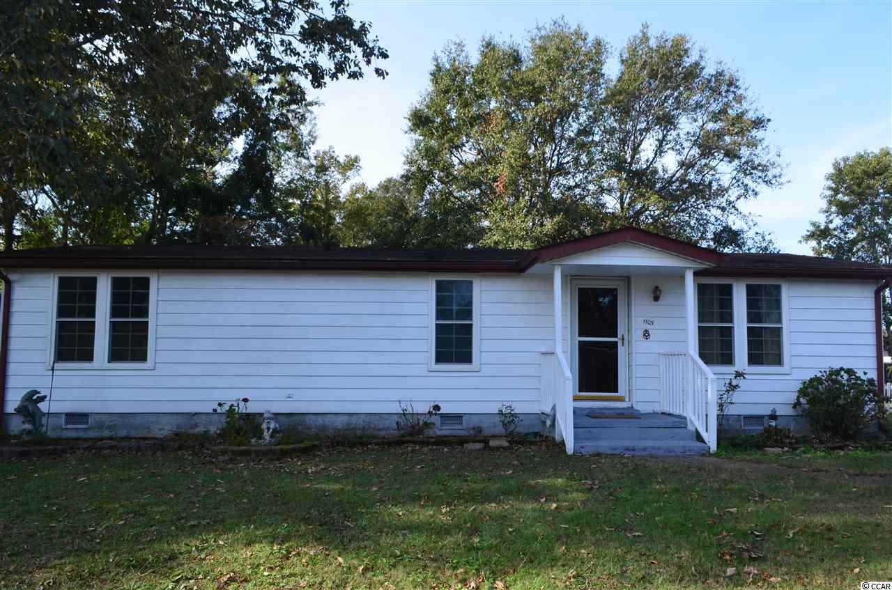 Great Location, Well Cared for Home in North Myrtle Beach. Enjoy comfort in this well established neighborhood in this 2 Bedroom, 2 Bath home.  The home features a large Master bedroom, Master Bath with New Counters, and a Walk in Shower.  The home has a Large Kitchen, work Island, great cabinet space and a breakfast nook. Likewise, there is a dining area next to the kitchen and Living Room.  There is a good size yard, fenced in with a 20x8 detached storage building.  Enjoy peaceful evenings under the stars and trees sitting on your covered back porch. In the hot summer, cool off in the community pool. Come see this today.