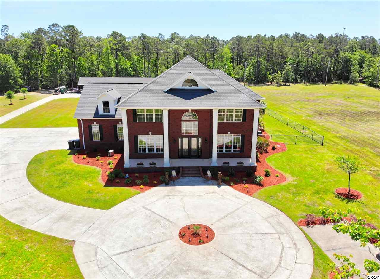 Magnificent and secluded 6.52 acre gated estate home with stocked lake and fountain, large mother in law two bedroom two bath apartment, additional separate detached studio suite with kitchen and bath.  Featuring expansive estate home with custom ceilings and trim throughout.  Full gym and workout facilities.   Three bay attached garage and additional detached multi-bay garage.  Beautiful and relaxing outdoor living space with covered living area, surround sound, and full outdoor kitchen with gas grill and separate charcoal grill, and a wood burning brick fireplace overlooking the salt water pool.  Perfect for entertaining.  All measurements and square footage are approximate.  Buyer is responsible for verification.