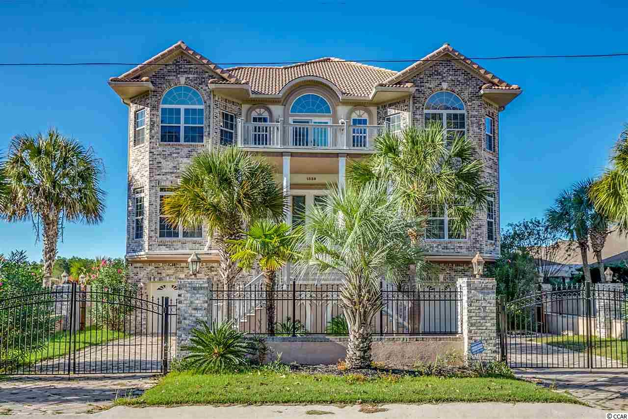 LOCATION, LOCATION, LOCATION. LUXURY LIVING ON THE INTRACOASTAL WATERWAY IN THIS 4 BEDROOM 5.5 BATH BRICK CUSTOM BUILT HOME WITH DEEP WATR DOCK, BOAT LIFT WITH COVER. ENTERTAIN AT YOUR OWN TIKI BAR BY THE POOL AND WATCH SUNSETS ON THE WATERWAY. TIKI BAR HAS A FULL KITCHEN WITH STOVE, REFRIGERATOR. THE INTERIOR IS 3 STORIES WITH AN ELEVATOR WITH FLOOR TO CEILING VIEWS. 2 SCREENED PORCHES AND A DECK OFF THE LIVING ROOM FOR AFTERNOON COCKTAILS. IT HAS A GOURMET KITCHEN WITH A WOLF STOVE AND SUB ZERO REFRIGERATOR, GRANITE COUNTERTOPS, CUSTOM CABINETS, 2 FULL SIZE PANTRIES. ENJOY YOUR DOUBLE SIDED FIREPLACE BETWEEN YOUR HUGH FAMILY ROOM AND KITCHEN AND A FULL BAR OFF OF THE LIVING ROOM. TWO FLEX ROOMS TO USE FOR WHATEVER YOU NEED. THE BOTTOM FLOOR IS A HUGH GAME ROOM THAT LEADS OUT TO THE POOL AREA WITH AN OUTDOOR SHOWER.