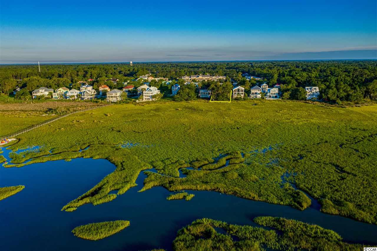 Lot 19 Sweet Grass is a beautiful homesite overlooking the marsh and viewing the Atlantic Ocean.  The breathtaking, unobstructed views overlook the inlet separating Litchfield and Pawleys Island.  The community offers residents a shared dock with private water access for kayaking, fishing, crabbing or just sitting on the dock/gazebo taking in the wildlife and all the coast has to offer for simple rest and relaxation.  The Sweet Grass community is centrally located and just an easy walk to the fabulous shopping at the world famous Hammock Shops.  The Fresh Market, Banks, medical facilities,restaurants and eleven golf courses are within a short drive to the Sweet Grass community and provide all the necessities and extras.  Just north on highway 17 Brookgreen Gardens and Huntington Beach State Park provide special events yearly for all to enjoy.  Approximately 20 minutes from Historic Georgetown with the Front Street river walk and fine dining and only 30 minutes to Myrtle Beach with all the activities from Minor League Baseball, Broadway at the Beach, wonderful shopping Malls and restaurants for a night out on the town.  Historic Charleston is approximately an hour away for those interested in Southern past and present.  Centerally located, Sweet Grass provides all the options for living at the beach and taking advantage of the ammenities that are just a short drive away.