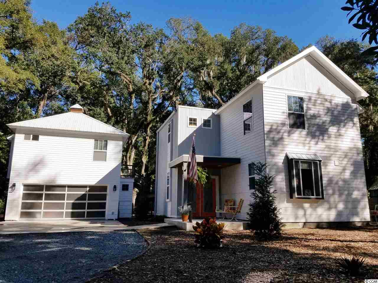 Welcome to Hagley Estates a fantastic golf cart community! Come enjoy this unique, Modern Southern style home with high end fixtures and finish.  The stairs, powder room countertop and window sills are crafted from an eighty two year old Oak tree which stood on property!  You'll love the modern cooks kitchen!!  The home has 3 large bedrooms all with their own bathrooms. Top of the line mini split HVAC system.  Extremely efficient, hybrid heat pump hot water heater.  All baths have one piece dual flush toilets and low water consumption faucets/showers.  Brick floor area prepped for outdoor shower.  Entire house is insulated with dense pack cellulose.    There is a separate entrance to the spacious mother- in- law suite that has a kitchenette, full bath and walk in closet. Now ,take a two minute walk across the street to the beautiful Waccamaw River and the sunsets. Three minutes to Hagley boat ramp, eight minutes to Pawleys Island beaches. Bring your boats and your RV's. No restrictions, no mandatory HOA. If you're looking for a tasteful one-of-a-kind, look no further!