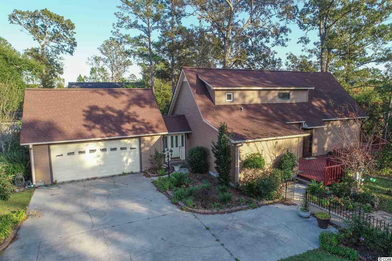 """***MATTERPORT LINK IS LIVE*** MORE PICTURES COMING SOON***  With this property, you are not just buying a home - but buying into a Lifestyle!!  This home sits high up on a hill overlooking the gorgeous Waccamaw River and provides a beautiful setting to relax and enjoy life!!  The home itself is a very spacious floor plan providing 2 bedrooms, 2 bathrooms, bonus areas and a walk-out basement/bonus area beneath the home.  This home boasts a beautifully updated kitchen, a large master bath, and outstanding views through the large floor to ceiling windows in the living area facing the river.  Use this home as your everyday getaway from the """"hustle & bustle"""" of Myrtle Beach, your retirement home to relax in, or as your """"home-base"""" for traveling the ICW by boat!!  There are so many opportunities and flexibility provided by this home, so come see what kind of fit it has for you!!"""