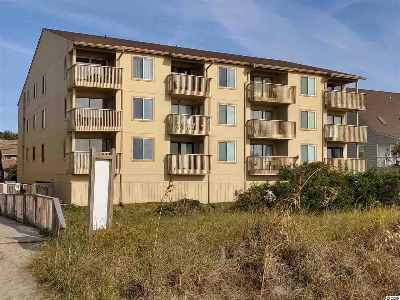 Welcome to your spacious DIRECT oceanfront 3 bedroom condo at Coastal Dunes!  Enjoy full unobstructed views of the ocean from the living room balcony, or another access from the owners' suite. There is beautiful new flooring throughout the main areas and new furniture. All the furniture conveys, this unit is move in ready! Great  for a primary residence, secondary home, or investment. There is a fully kitchen and washer/dryer that conveys. A pool belongs to Coastal Dunes with the option for under building parking.Located in the heart of Crescent Beach in North Myrtle Beach, this condo will feel like home. Just a short drive from Main Street, plenty of dining, entertainment, and lots of golf.This is a smaller and quaint condo building that has only 12 units, come and be 1 out of the 12!