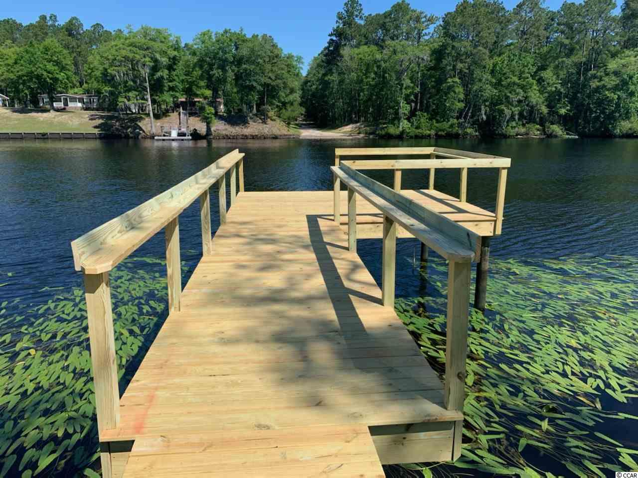 This is a rare opportunity to own a place on Black River and truly make it your own.   One of the last remaining waterfront lots on Cherokee Drive, this 1 acre property cleared and ready to build a house. With 125 feet of waterfront, the property features a deep well but the owner will have the option to join the county water system if desired.   The space for a future home sits on a high hill and provides many opportunities. Between the hill and the river is a swampy area with a elevated walkway that winds through cypress trees. At the end of the walkway are pilings that have already been driven into the ground for a future dock, but a platform has not been constructed - also providing many opportunities to customize this feature to your liking.   Just 20 minutes from Georgetown by car and ~1 hour by boat, this places  makes he perfect weekend getaway.