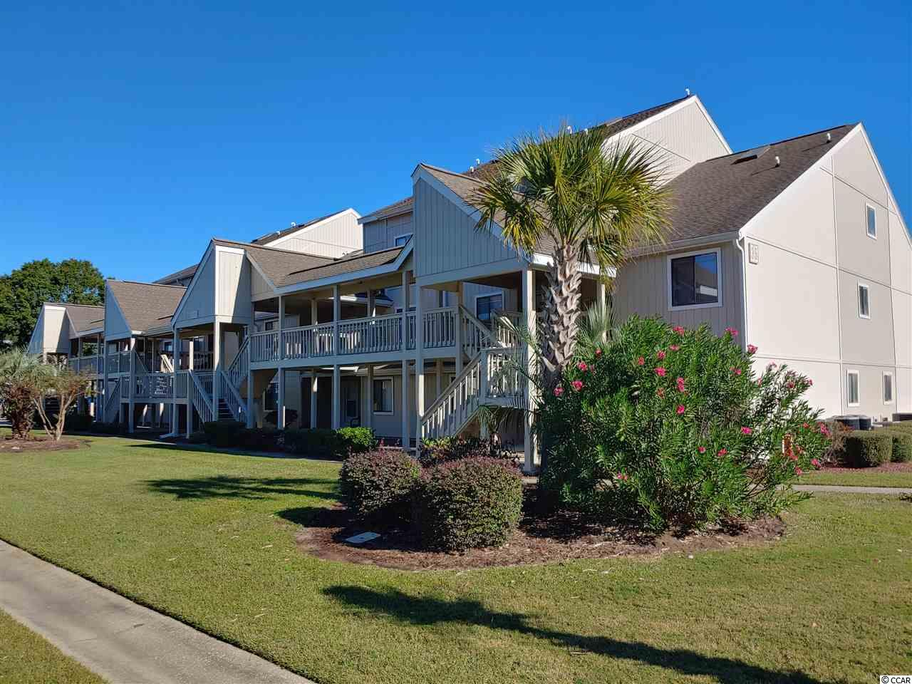 This is a Spacious 1 bedroom, 1.5 bath, Fully Furnished, 2nd-Floor condo in sought after Surfside Beach community of Golf Colony Resort! The condo's large bedroom has 2 queen sized beds and a spacious 18'x17' Living Room. The open floor plan has a great breakfast bar, which is perfect for entertaining! The covered deck overlooks the saltwater pool and the picnic/grilling area. There are also two very nice tennis courts for fun with family and friends! Golf Colony @ Deerfield is a great location that allows you to enjoy the convenience of going right across 17 in Surfside to get to the beach and also has a back entrance on 17 Bypass to do quick shopping! It is only 15 minutes from Myrtle Beach International Airport and The Famous Murrells Inlet MarshWalk, where you'll enjoy everything from fresh caught seafood to some of the best live bands! This gem is move-in ready!