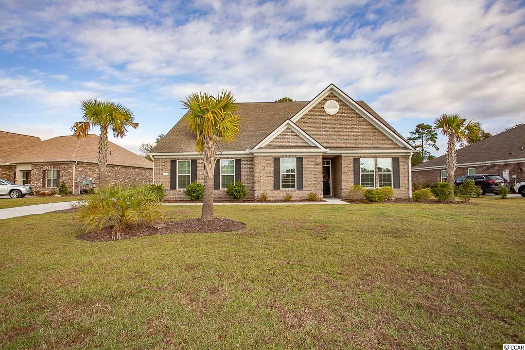 Beautiful brick home with a Beautiful view of the golf course complete with spacious living area, modern appliances, granite counter tops, wood floors, and two car garage.  Open floor plan includes five bedrooms and four bathrooms. The 5th Bedroom is upstairs with its own Private Bathroom!   Amenities include two pools w/ slide and hot tub, exercise room, meeting room, clubhouse, two tennis courts, and basketball.  There is also boat and RV storage.  Close to the beach and all area attractions as well as the CCU campus.  Refrigerator, window treatments, washer, and dryer will convey. Owner is a Licensed SC Realtor