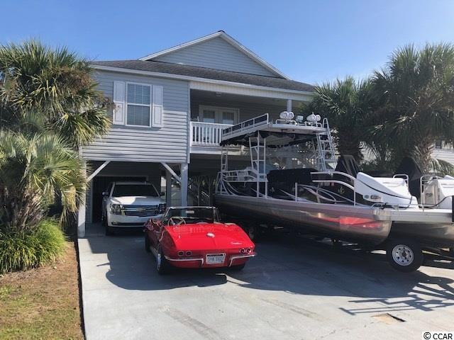 Your beach home awaits! Beautiful raised beach home in the heart of Cherry Grove, only 2 blocks to the ocean! This 4 bedroom 3 bathroom has All new paint throughout and NO Carpet! New HVAC system in 2018 and enough parking for you and your Boat. Great landscaping with beautiful palm trees.