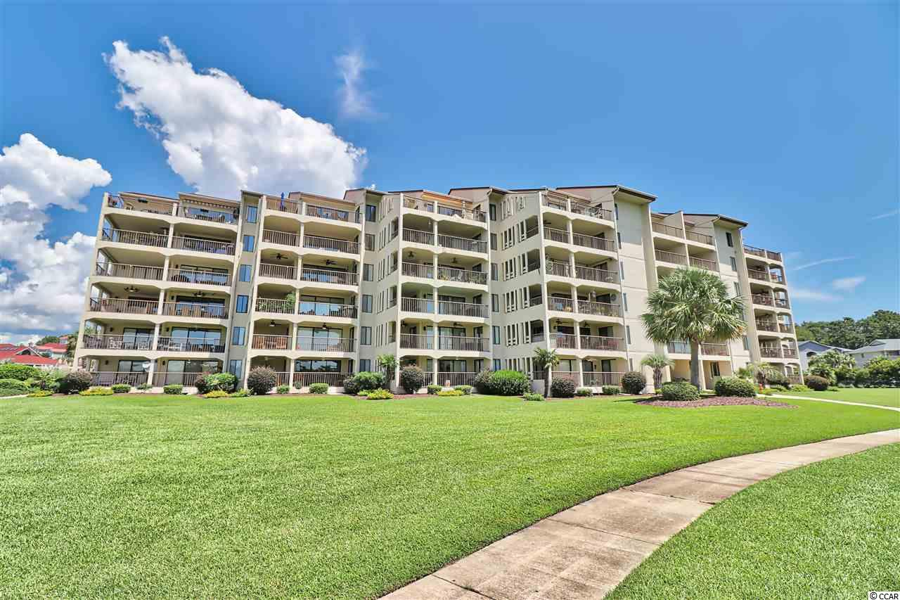 ATTENTION BOATERS.... This large furnished, ground floor condo comes with it's own 36' boat slip! (#J-9). The location and reasonable HOA dues, make Coquina Harbour one of the most preferred locations along the Grand Strand.  Enjoy the breathtaking views as the sun sets over the harbour and you sip on your evening beverages, taking in the coastal breezes from your large L shaped porch. The spacious porch in perfect for entertaining and is accessible from the master bedroom, as well as the living room. This Coastal Living Lifestyle is waiting for you!