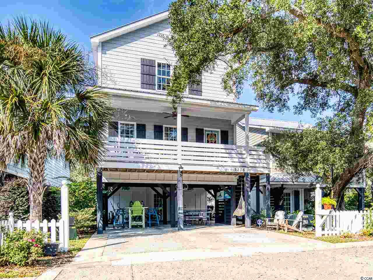 Live your best life in the heart of Murrells Inlet in this beautiful 3 bedroom 3.5 bath raised beach house. Located east of bypass 17 and in close proximity to the water. Perfect for guests, the ground floor offers a bedroom, full bath and walk in closet with private entrance, also separate from the rest of the house. The main floor offers an open floor plan with custom build ins, cabinetry, and wainscoting throughout the living and dining areas. Kitchen was remodeled in 2019. Enjoy an afternoon cocktail on the spacious front porch. The top level features a master suite with vaulted ceilings, laundry room and additional bedroom and bath. The bottom floor also features two attached storage areas and back patio.   Only minutes from the popular Murrells Inlet Marshwalk that features numerous waterfront restaurants, watersport opportunities and festivals throughout the year and just a few miles south the Murrells Inlet Bike Trail, Huntington Beach State Park and Brookgreen Gardens. Only 20 minutes from the Myrtle Beach International Airport and other popular attractions, such as live musical and theater productions and a vibrant nightlife.