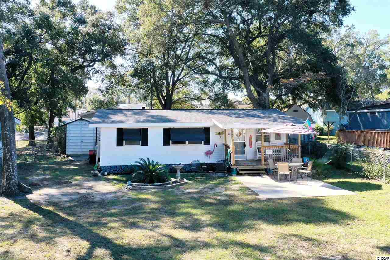 A PIECE OF THE BEACH WITH AN AFFORDABLE PRICE TAG! FULLY FURNISHED HOME!!! This property was originally a single wide manufactured home, but has been added on and renovated in 1999. This home has all the big ticket items replaced and up to date such as, roof was replaced in 2018, HVAC replaced in 2016, hot tank-less water heater, granite counter tops, brand new floors, brand new cabinets, fresh paint throughout the whole house, and beautiful stainless steel appliances all done in 2016. Quick and easy golf cart distance to the beach! This home is located near all shops, restaurants, golf, and entertainment North Myrtle Beach, SC has to offer. With NO HOA's! Buyer is responsible for all measurement verification. Come schedule an appointment to view this property today! You will be glad you did!