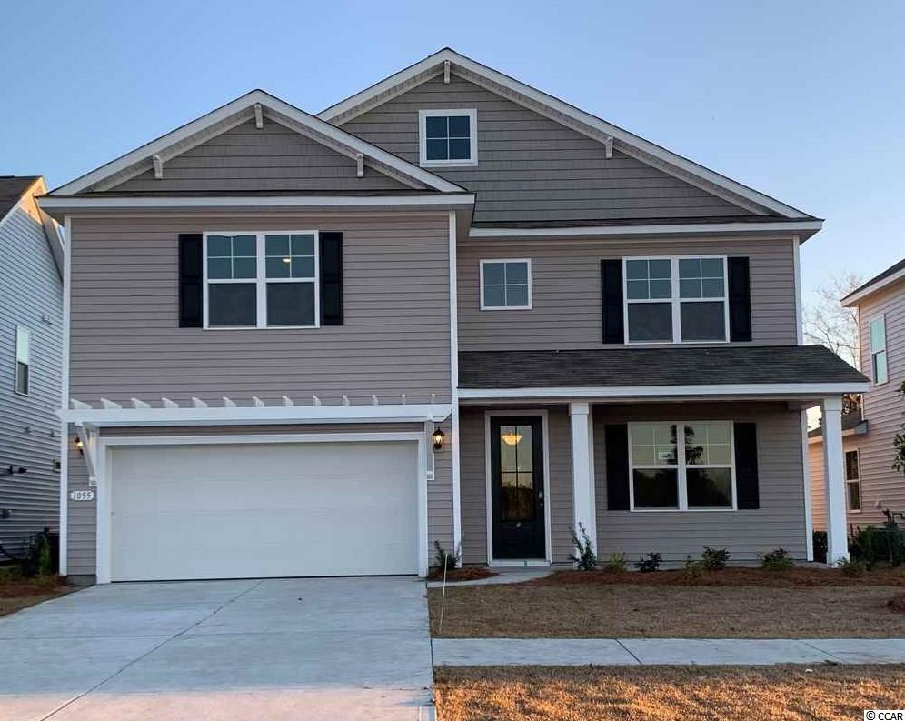 Gorgeous Tillman in a brand new, natural gas community in Carolina Forest! Engineered hardwood floors flowing throughout the dining room, kitchen, living room, and powder room. Incredible standard features including granite counter tops, stainless steel appliances with a gas range, and an oversized island in the kitchen. Master bedroom suite is conveniently located on the first floor. Upstairs there is a spacious loft area, along with 4 large bedrooms, two full baths, and a laundry room. *Photos are of a similar Tillman plan. (Home and community information, including pricing, included features, terms, availability and amenities, are subject to change prior to sale at any time without notice or obligation.  Square footages are approximate.  Pictures, photographs, colors, features, and sizes are for illustration purposes only and will vary from the homes as built.  Equal housing opportunity builder.)