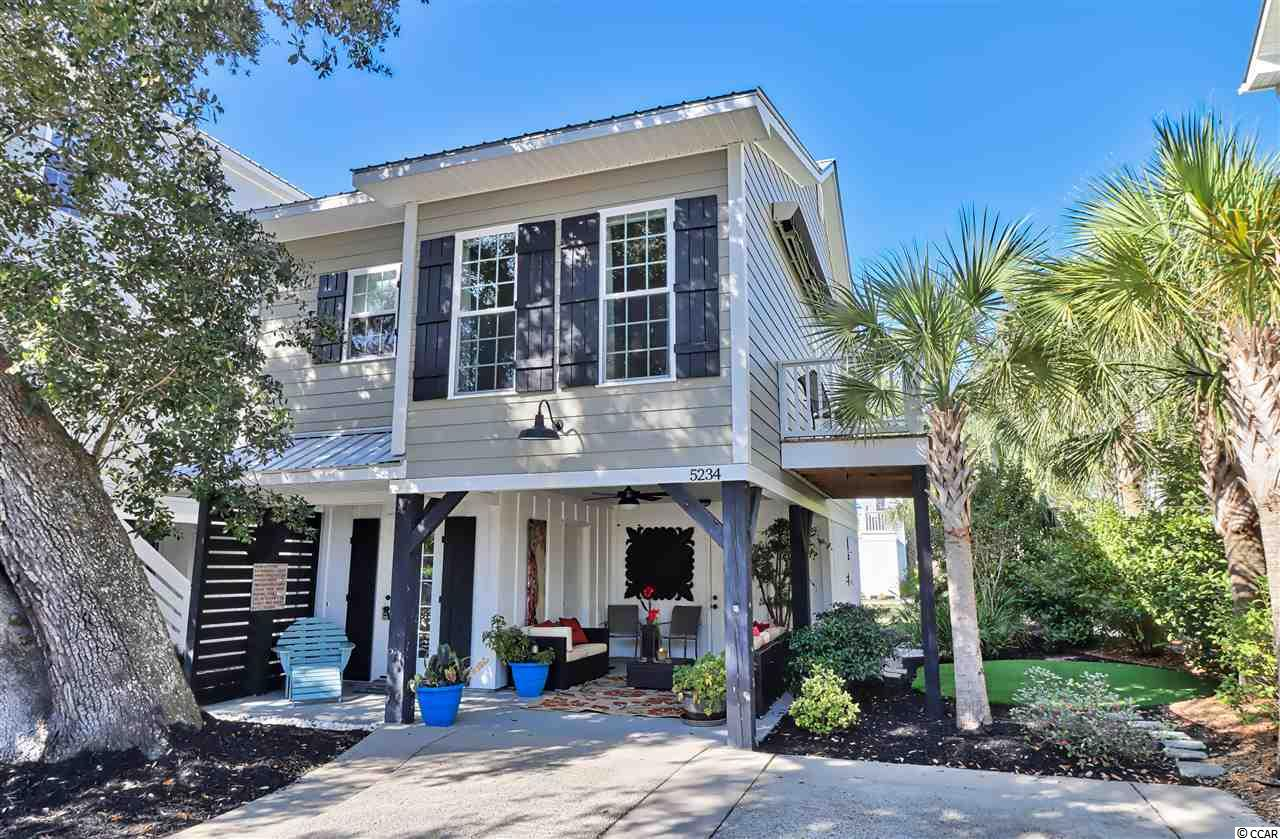 If you've been searching for the perfect Murrells Inlet getaway home east of highway 17 and only a few rows back from the inlet, then search no further! This is the perfect retirement home or secondary vacation home at an even more perfect price. You will not find another raised beach home of comparable value east of highway 17 in all of the inlet. Only a stone's throw away from the inlet and everything the famous South Carolina Marsh Walk has to offer. Whether you are an avid boater, nature enthusiast, or just love living the lowcountry lifestyle, this home can accommodate anyone. Under the home you can enjoy the outdoors with a wonderful sitting area and a storage room, or you can use for your car or boat as well. On the right side of the home you can take advantage of the outdoor shower after a day on the water or the beach. Upon entry of the front door, you will find a cozy bedroom and full bath on the first floor that would be perfect for hosting a guest, or could be used as an office or second tv room. As you make your way upstairs, you will discover an amazing kitchen, dining, and living space with vaulted ceilings that bring in all the natural light you could ask for creating a truly spectacular and charming home unlike anything else currently on the market. This space is perfect for entertaining or enjoying every square inch of it yourself. The master bedroom is also on this level with a full master bath and walk-in closet. Off the living room there is also a deck with retractable awning so you can also take advantage of enjoying the outdoors from up there as well. This home is located in the southern part of the inlet far enough away from any hustle and bustle, but close enough to all the restaurants, bars, shopping, bike trails, golf courses, Huntington Beach State Park, Brookgreen Gardens, and only a convenient 20 minutes to Myrtle Beach International Airport. This is a truly unique opportunity that doesn't present itself very often in Murrells Inlet. Wh