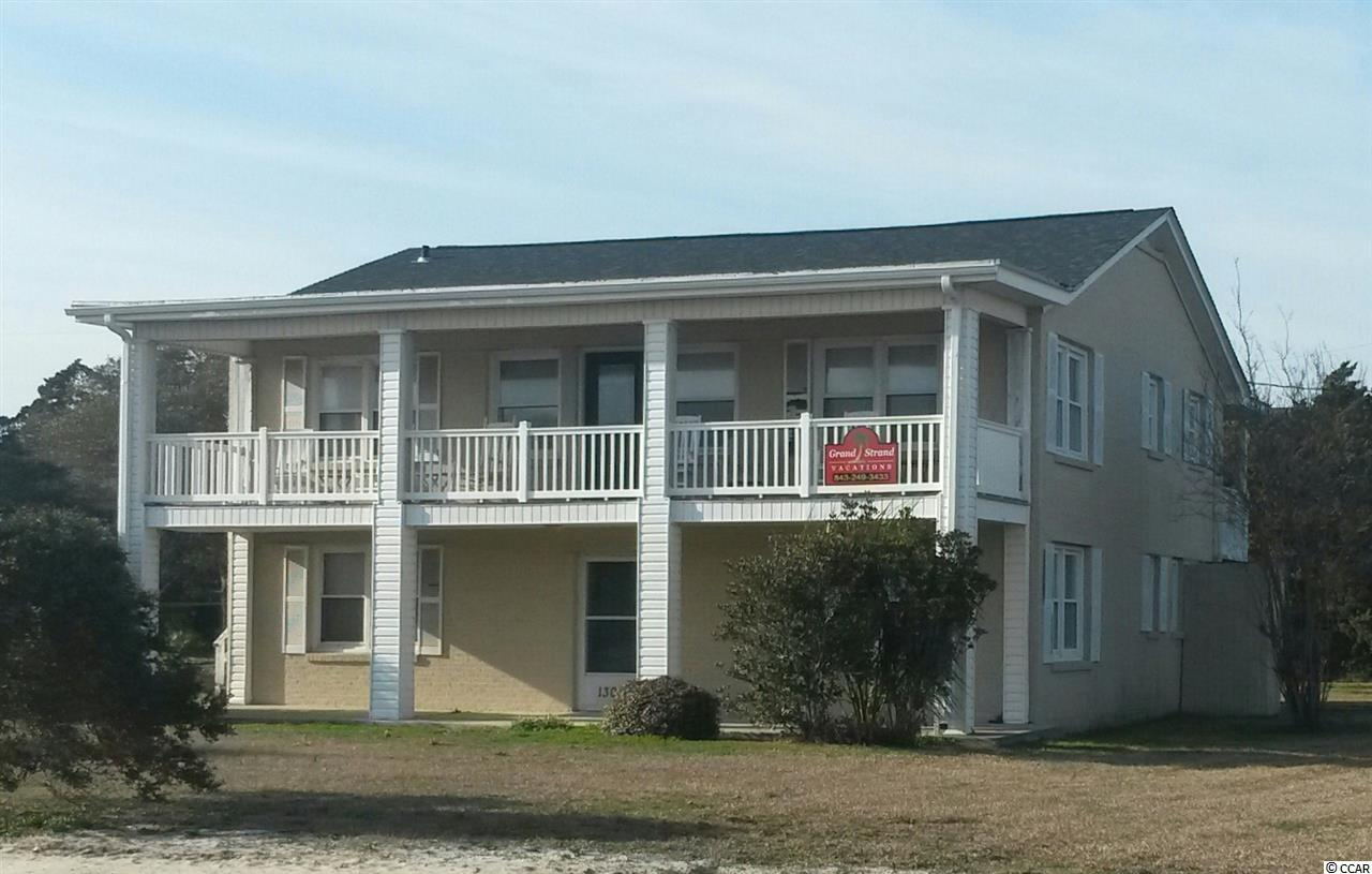Old-style, second row beach house on large, corner lot in the Tilghman Estates area of the Ocean Drive section of North Myrtle Beach. Located diagonally across from beach access. Large ocean facing balcony. Sleeps up to 20. 5 bedrooms, 3 bathrooms, 3 half baths, 2 living rooms, and an extra large room with bunk beds. Hardwood floors and pine paneling. New tile floors on first floor. Custom 9 foot dining table. New roof, 2 new HVAC systems, new waterline and sewer line. New trim paint. Recently replaced mattresses. Re-enforcement of decks and porch just completed. They say that if you want your grandchildren to visit you, buy a place at the beach. This house has room for an extended family of children and grandchildren to visit all under one roof. A grandmother's dream, and a grandchildren's delight. Parking on 14th Avenue North side of lot at right angles to the avenue. Square footage, dimensions, features, etc. not guaranteed. Buyer responsible for verification.
