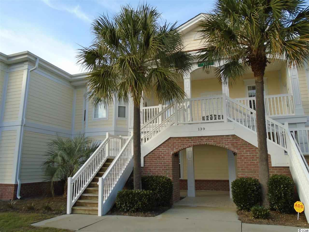Nicely and completely furnished Green Haven - only upstairs, corner villa on the market at the present time.  The building is located at the end of Avian Drive with common area on one side; a single family neighborhood is located in the rear camouflaged by Leland Cypress trees; 4 BRs, 3 Baths (1850 heated sq.ft.) with lockout availability; additional features include a screen porch and detached single car garage; Bike or golf cart ride to your private beach access through LBTS with bike/walking paths, tennis courts, fishing/crabbing docks and ocean front club house; convenient to shopping, restaurants, marina and golf courses; located nearby is famous Brookgreen Gardens; Historic Charleston is 90 minutes to the south and Myrtle Beach is only 45 minutes north.