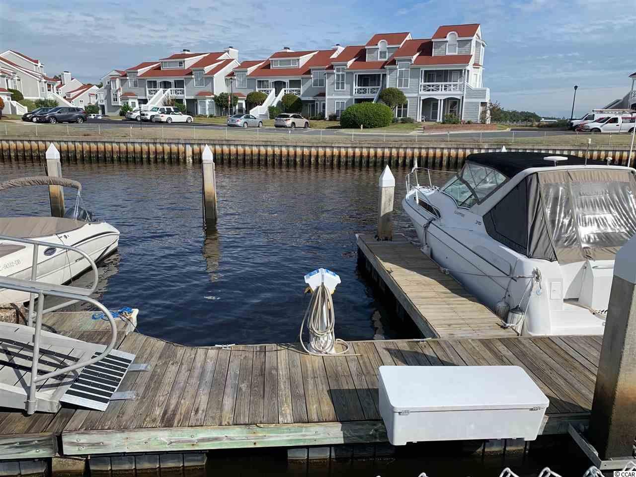 One of the closest slip to the ICW!  Located just at the entrance to the Marina at Mariners Pointe, this 35 ft slip is one of the best locations!  Park right in front of your boat, with ramp and entry gate right in front of the slip.  Mariners Pointe is an upscale waterway community filled with extras!  Boat slip ownership allows you access to all of the amenities they have to offer.  The pool, private owners lounge & bar, tennis courts, basketball courts, and club house are all included with a low monthly HOA fee.  There is also an on-site dock master and pump out station. You will have your very own storage bin right beside your boat slip for your convenience. This is a boat slip you don't want to miss, easy access from your car once you arrive and even easier access in and out of the marina!  Mariners Pointe is a gated community with 24 hour video surveillance. The marina requires key card access so your boat is secure as well.