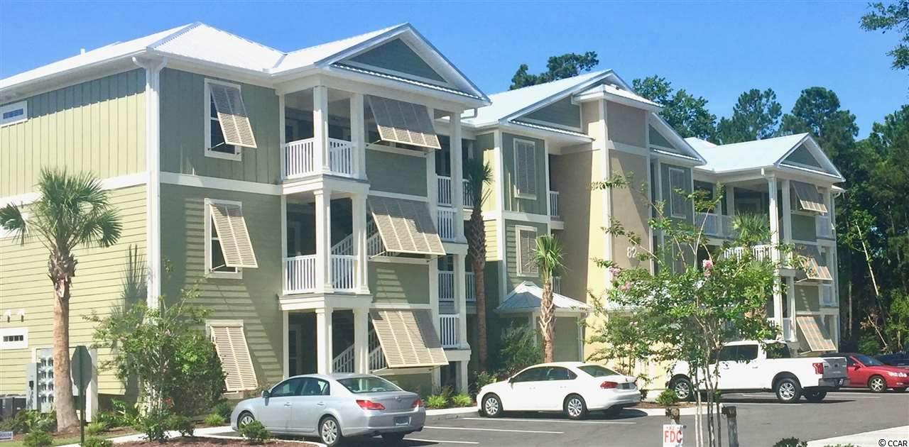 """Located in the heart of Pawleys Island, this condo offers easy and convenient coastal lifestyle living. An affordable opportunity to have your own place at the Beach. There is an extra """"flex room"""" which may be used for an office, playroom or spare bedroom. Elevators and a pool, hardwood floors, granite countertops, and a screened porch are a few of the details you'll love! While being located near public tennis courts, a fitness club, shopping and dining, you are also only a short drive to the beach, the river, golf courses, marches and marinas. This home offers all that you are hoping for in a SC beach community. Photos are from a previously built """"sister"""" condo community in Pawleys Island."""