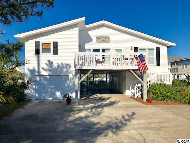 Good rental income... A gem of a gem of a creekfront home with a private dock, new sea-wall, in-ground creekfront pool and just three rows from the beach.  And yes, you can see the ocean from the house.  It's an open floor-plan and has a big creekfront porch for family fun.  Sells mostly furnished too!