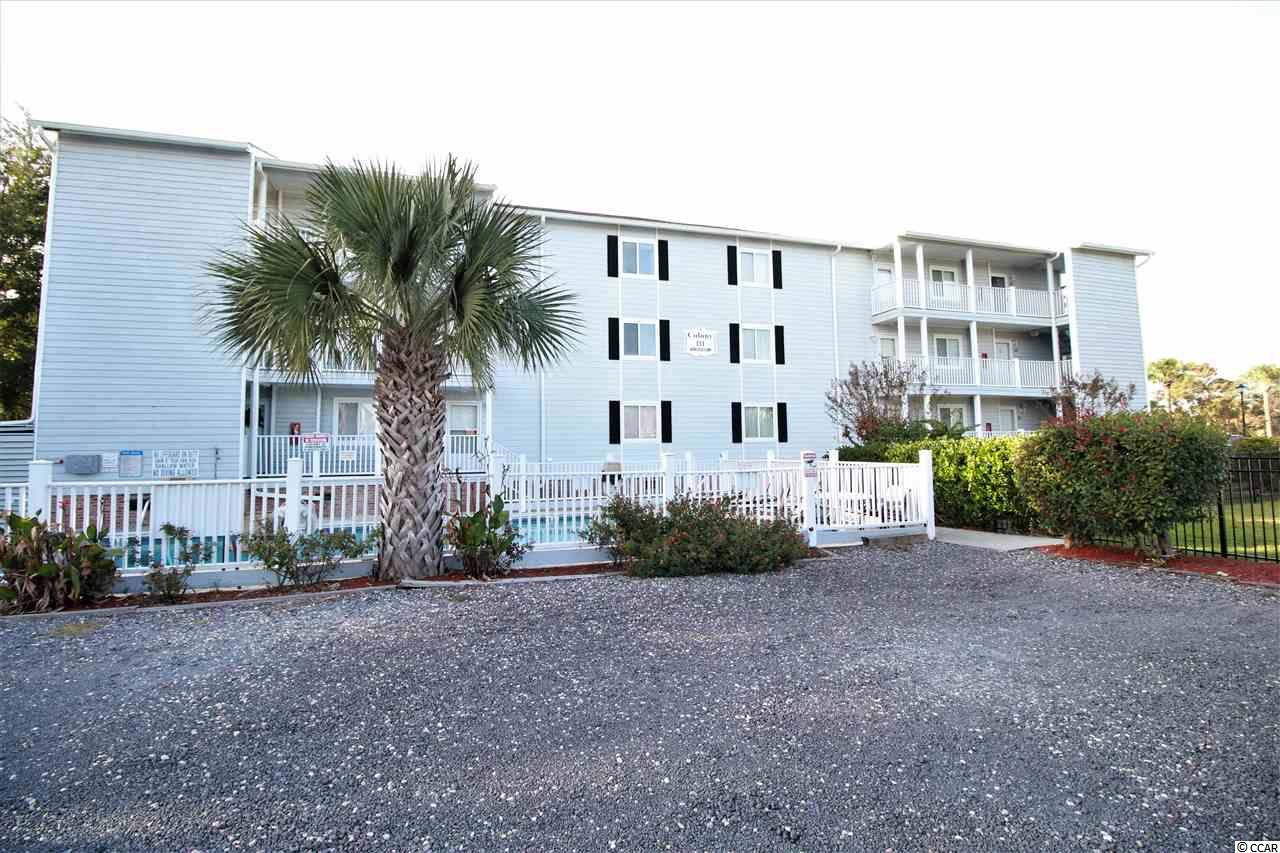 Welcome to Surfside Beach...The Family Beach!    This 2-bedroom, 2-bath condo Has So Many Unique Features and Benefits.  Custom Stone Wall In Living Room.  New Within The Past Year Are HVAC System, High End Hot Water Tank (w/lifetime warranty), Flooring & Paint.  Located Just one short block (400 feet) To The Beach & Features A Relaxing Lake View From Your LARGE Screened-In Porch.  Ideal Beach Getaway!  Relax By The Spacious Pool or Fish From The Private Dock.  This Unit Has The Unique Benefit Of A Private Charging Outlet For Golf Cart or Hybrid Auto.  YES, GOLF CARTS ARE ALLOWED!  Plenty of Parking Year Round.  Short Term Rentals ARE Allowed.  New roof 2017.  All information is deemed accurate, but not guaranteed.  Buyer to verify all room sizes and info.