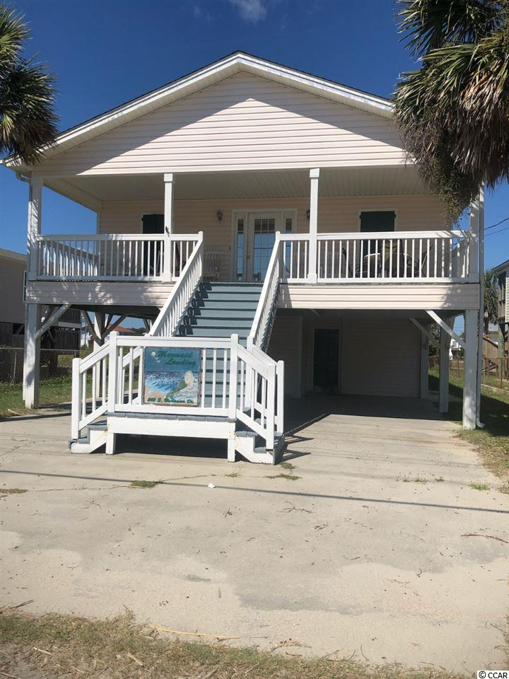 This house is one of the best on the Beach! Extensively rebuilt, remodeled and reworked from the ground up in 1999 this home is true Garden city living at its finest! Great location across from the public beach access and only 2 blocks from Garden City Pier! Sit on the front porch and watch the ocean come in or get lost looking out across the waves. Feel safe hosting parties and family get togethers because you can entertain on the large porches and under the main floor when the weather isn't cooperating. While the front porch is perfect for ocean gazing, the back porch is perfect for watching the sunset. Add all these features with front and rear parking  and you realize this home has tons of room and potential.  This home is close to amenities and would be perfect for a winter getaway! There are multiple rental management programs available to provide income while your not staying and takes the hassle out of renting. Some pics are from summer and some are from winter to show how the home shines in different seasons. If you are looking for a great home in the heart of the area, you truly owe it to yourself and your loved ones to see this home. Make an appointment to come out and see it today!