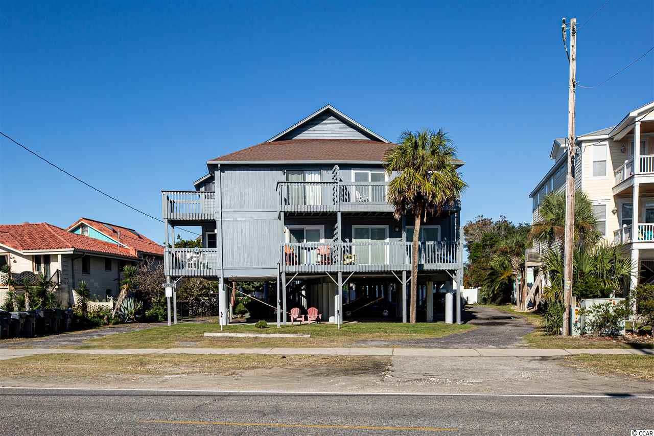 Own your own piece of paradise right across from the ocean!  This 2BR / 2BA condo comes fully furnished and has been recently updated with new vinyl hardwood floors throughout.  The deck which overlooks N Waccamaw BLVD has been recently replaced along with two new sliding glass doors.  Both Bathroom floors recently tiled along with recently updated HVAC (2018) and Water Heater (2017).  This Home is Move-In Ready and can be used in so many different ways, Own instead of renting, second home or as an investment property.  Only 8 Units in the entire building and location is PRIME!