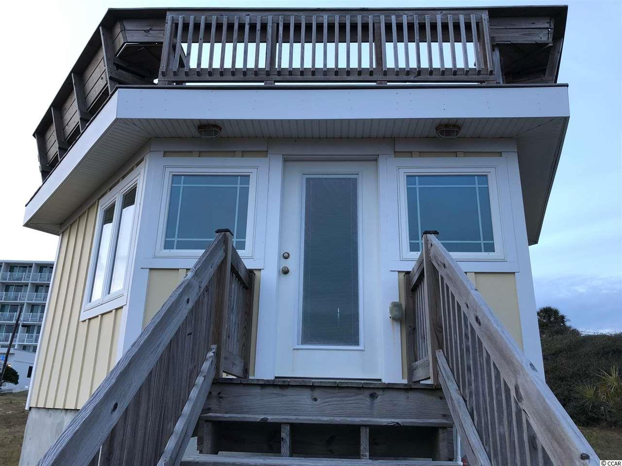 Own your very own piece of oceanfront paradise.  Rare opportunity to own one of the most unique types of real estate in Myrtle Beach.  This Cabana was completely remodeled in 2015 with all the best.  Heating and cooling, granite counter tops, gas range, and full bath.  This is the only Cabana with a roof top deck and the lot has a curb cut off Ocean Blvd.  It also has a basement (dry) for all beach toys!  This cabana is NOT a residence and cannot be lived in.  While it sits on one of the largest lots in the cabana section, the largest structure zoning will allow is 250SF.  It is for day use only (zoning says you cannot stay in a cabana overnight. However how late you can stay is well...) while allowing the owner parking and access to the beach in an area where there are no public beach accesses and no public parking. This means that when the rest of the beaches are packed in the high season you have your own private parking, beach access full cooking, bath and air conditioned escape along a beach with much less density.