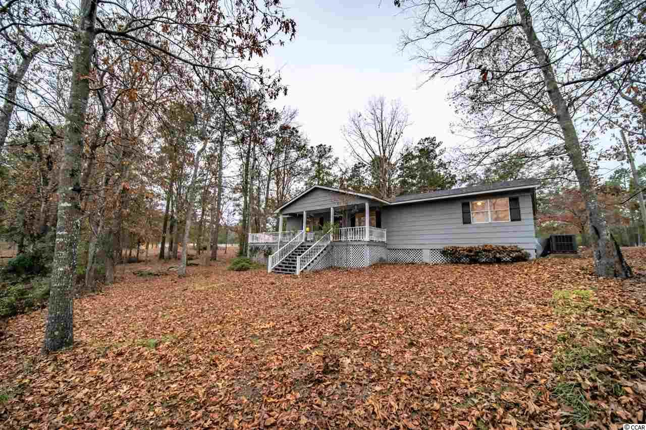 Enjoy a tranquil setting with views of the majestic Black River. Located in the  Willie Towne community with 100 feet of frontage along the Black River and a deeded private neighborhood boat launch. The living, kitchen and dining area boast beautiful reclaimed heart pine floors. This home offers spacious bedrooms and closets. Large Rear covered porch and wood deck for taking in all the beauty that Black River has to offer. Recreational opportunities are endless. Centrally located between Charleston and Myrtle Beach and 30 mins from Pawleys Island Beaches.