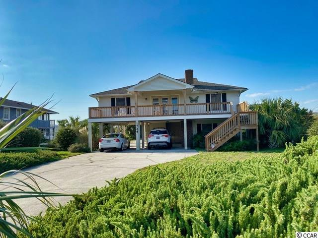 Endless possibilities! Truly! Situated on a large lot, directly across from the ocean, 1734 S. Waccamaw Drive offers so much. This five bedroom, three bath home has plenty of space for family and friends, has views of the ocean and marsh and multiple porches to enjoy. What a great opportunity to own a beach house that has so much potential, yet at an obtainable price! Be sure to check out the walking tour of this property on my YouTube channel