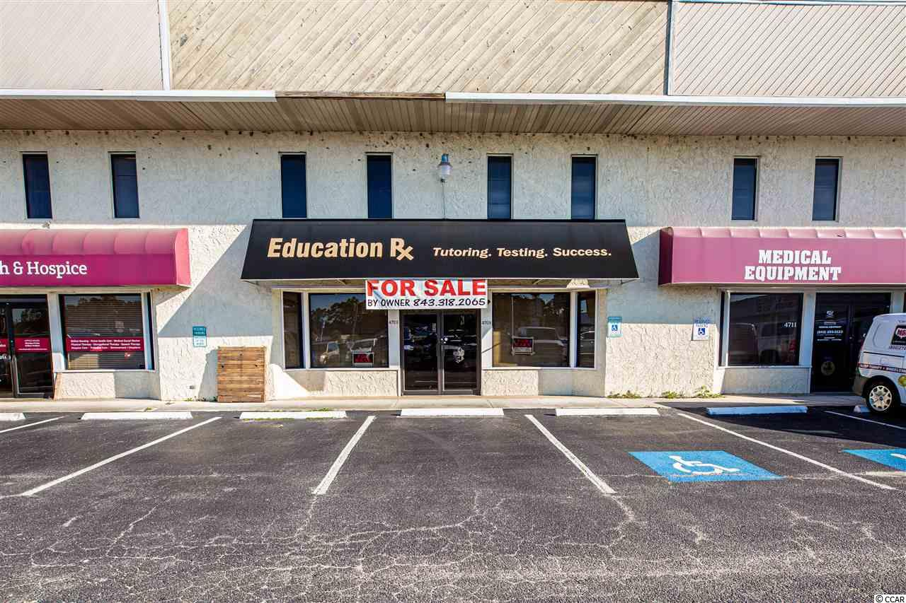 This is a great opportunity to own over 4000 sqft of commercial space centrally located near The Market Common in Myrtle Beach. Right off of 17 Bypass on the Frontage Road, there is a lot of potential for these offices to have several different uses. There are 4 offices WITHIN this unit with separate entrances and utilities. The first floor 2 offices have been merged as one, but could be separated back to 2 if desired. There is a lot of flexibility and potential with these units!