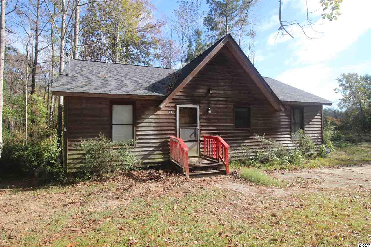 Creek Front cabin awaits. This cul-de-sac lot with frontage on Peters Creek offers a 1200 sq ft home with three bedrooms, two baths, and open great room kitchen combination. Master bedroom has its own bath and closet. Fourth room serves as a bonus room or home office. Peters Creek is a tidal creek that empties into the Black river just a half mile down from this home. Enjoy fishing, paddling, and watersports.