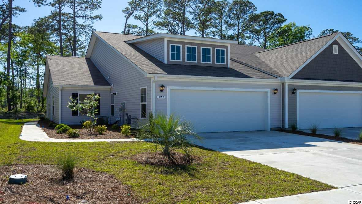 "Lovely, low maintenance, paired ranch home in a brand new community! This Tuscan floorplan offers a spacious, open layout all on a single level. With vaulted ceilings, tons of natural light throughout the living and dining areas, large kitchen island, and spacious covered patio, this home is perfect for entertaining! The kitchen also features granite countertops, stainless steel appliances, 36"" staggered cabinets, and large pantry with ample storage. Roomy master suite with walk-in closet and private bath with dual vanity and 5' walk-in shower. This home also features hardwood look rigid core board vinyl flooring in the main living areas, bathrooms, and laundry, a tankless water heater, and our Home Is Connected smart home package. Yard and exterior maintenance are all covered! *Photos are of a similar Tuscan home.  (Home and community information, including pricing, included features, terms, availability and amenities, are subject to change prior to sale at any time without notice or obligation. Square footages are approximate. Pictures, photographs, colors, features, and sizes are for illustration purposes only and will vary from the homes as built. Equal housing opportunity builder.)"