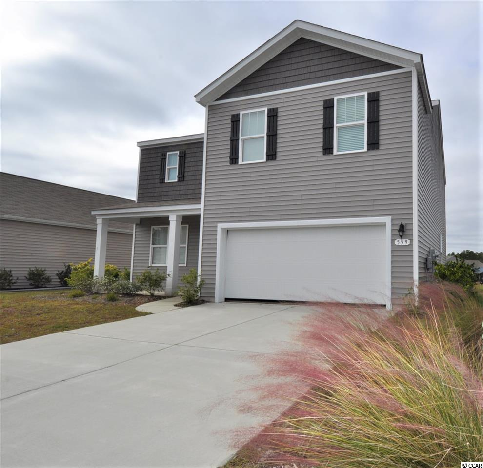 Located in the highly desirable community of The Farm in Carolina Forest, this home is only 2 years old and move in ready! With a traditional feel and over 2400 heated square feet, this 2 story beauty offers a wide open floor plan with pond view. Downstairs you will find a huge great room, kitchen, 1/2 bath and flex room which could be a formal dining room, office, bonus space or whatever else you choose! The kitchen boasts granite countertops, white staggered cabinets, a large island with pendant lighting that can double as a breakfast bar, SS appliances and a walk in pantry. Upstairs you will find the  20X13 Master with ensuite that offers a vanity with double sinks, a walk in shower and separate tub as well as 3 additional nice size bedrooms, a full bath and laundry room with washer and dryer included. Don't miss out on this great price! The Farm is truly one of the most sought after, family friendly communities on the Grand Strand and offers tons of amenities including 2 pools, a playground, basketball court, fitness center, and homeowner planned events and activities.  The Farm is conveniently located to everything including schools, restaurants, shopping, health care, Highway 31 and the beach. Schedule your showing today!