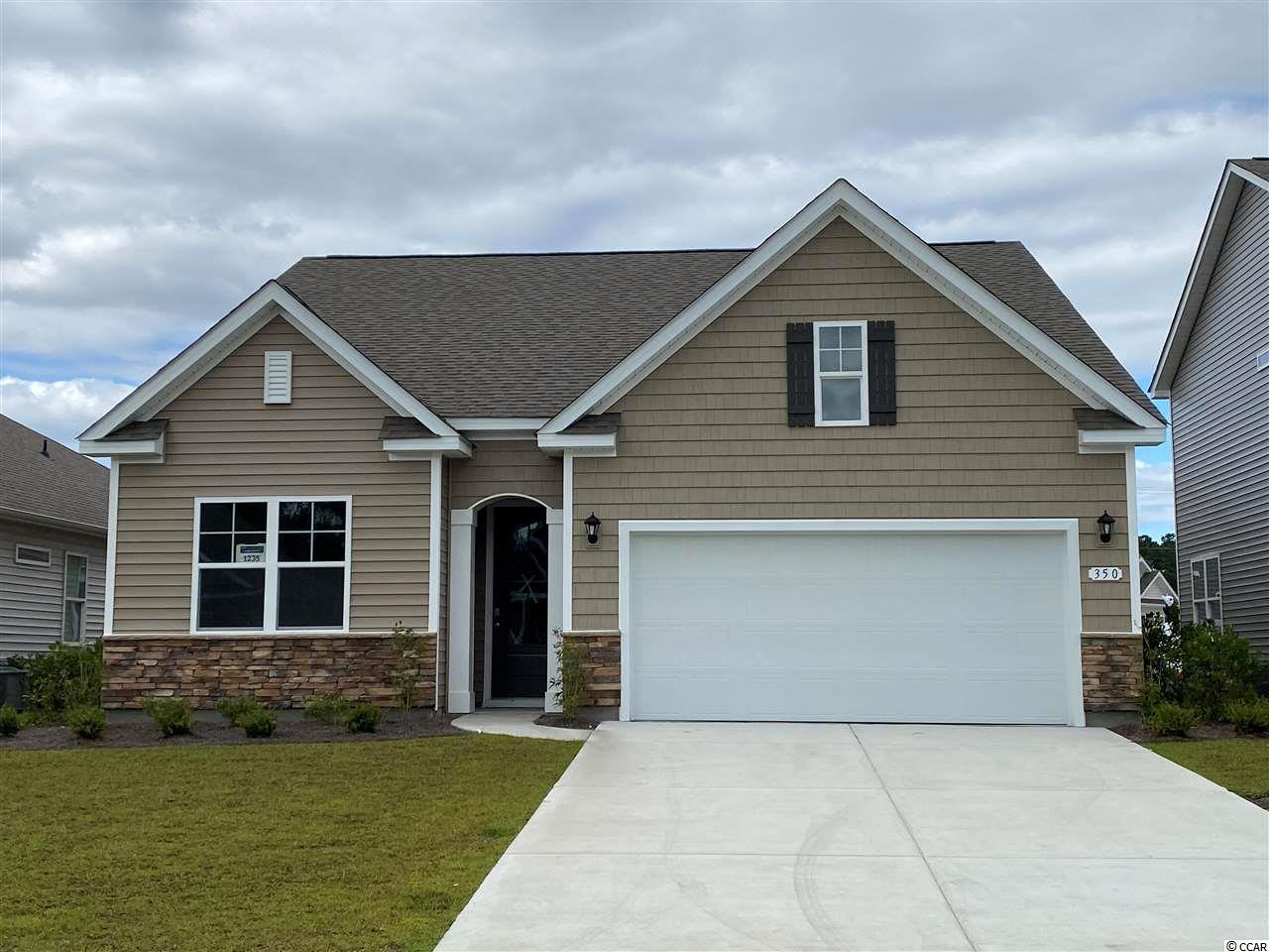 "The very popular Acadia floor plan is now available in our new, natural gas community! This home features a beautiful exterior with stacked stone accent and arched entryway. Inside you will find a very open layout with 9' ceilings and an extended living space. The kitchen boasts a large pantry and nice upgrades, including granite countertops, 36"" painted maple cabinets, and stainless steel appliances with a 5 burner gas range. The split bedroom plan offers a private master suite with a large walk-in closet, and en suite bath with a double vanity, 5ft. shower, and linen closet. This home also has a covered porch off the living room which is great for morning coffee! Ask about our Home Is Connected smart home package that is included in all of our homes.Hidden Brooke is a beautiful community with an amenity that includes a pool with large deck area, clubhouse, and exercise room. Minutes away from Highway 31 which provides quick and easy access to all of the Grand Strand's offerings: dining, entertainment, shopping, and golf! Tranquil setting just a short drive to the beach. *Photos are of a similar Acadia floorplan. (Home and community information, including pricing, included features, terms, availability and amenities, are subject to change prior to sale at any time without notice or obligation. Square footages are approximate. Pictures, photographs, colors, features, and sizes are for illustration purposes only and will vary from the homes as built. Equal housing opportunity builder.)"