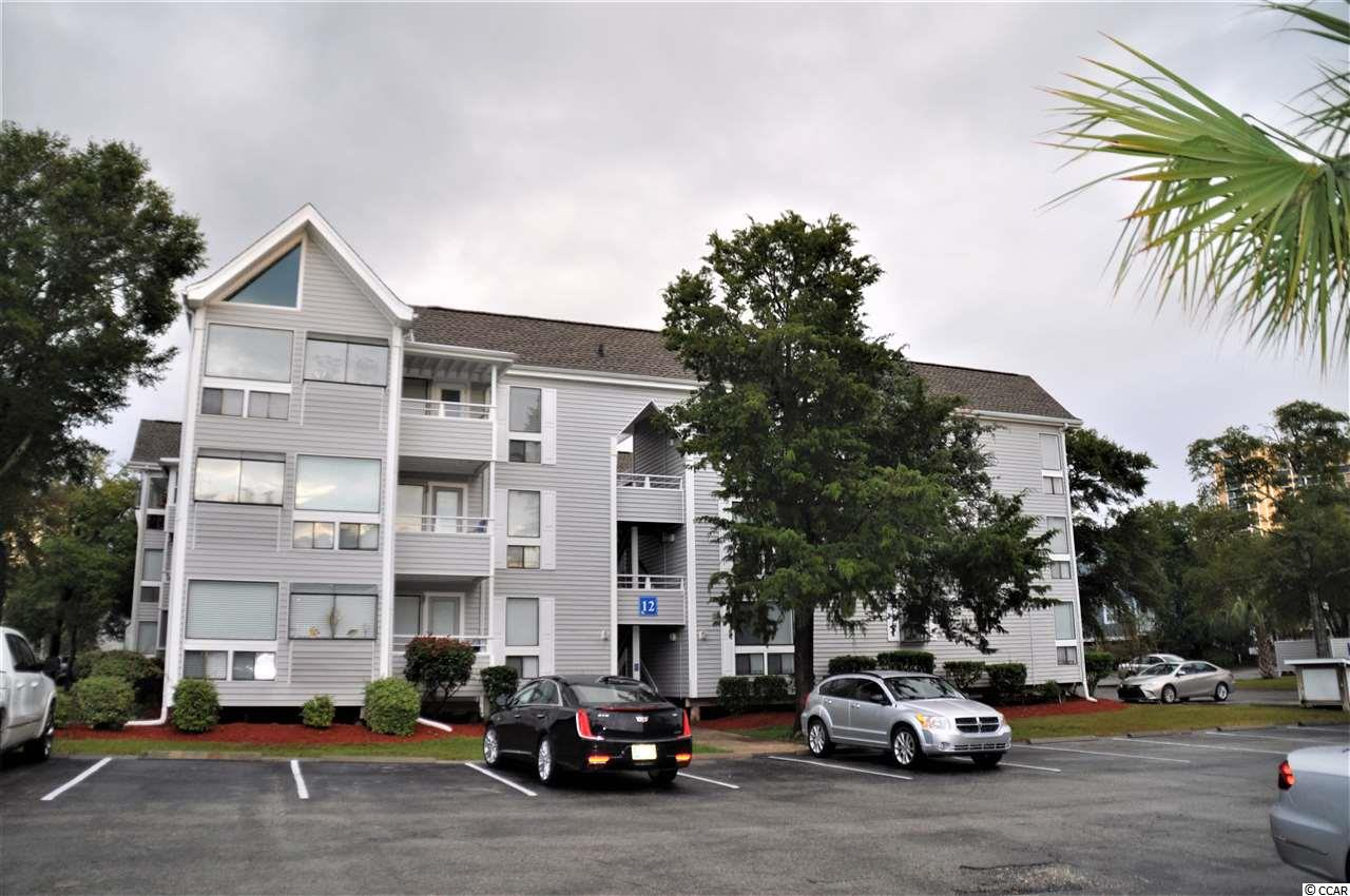 """Beautiful 2 bedroom/2bath condominium on the second floors with windows that browse out over the community. Walk downstairs and enjoy lunch, or a cold beverage at the """"Harry The Hats,"""" famous poolside bar. Condo is only a short walk to beach, and minutes away from restaurants and so many more fun activities."""