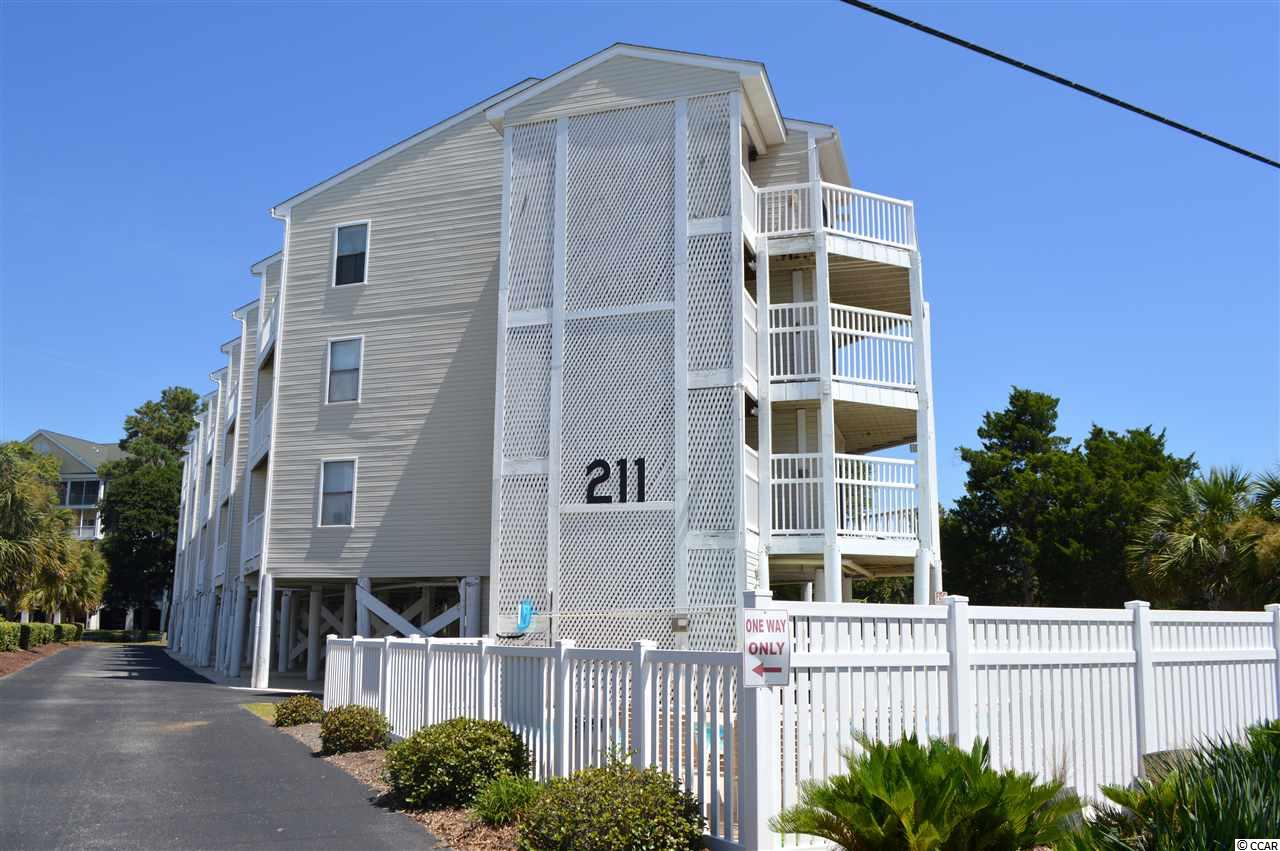 Location, Location, Location!  This very cute 2 bedroom condo features fresh paint and new carpet and is located just a block from the beach in popular Ocean Drive section of North Myrtle Beach. Living room and dining room are separate and open to the kitchen. Both bedrooms open onto a back deck and the living area opens onto a screened porch with a beautiful lake view. Walking distance to Main Street which features, food, shopping and entertainment.