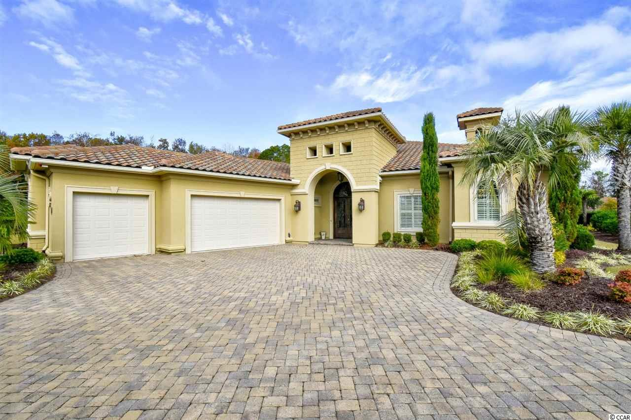 Rare opportunity to own this luxurious, 4300 sq. ft. (under roof) 4 bedroom, 3 bathroom, FORTIFIED home situated on a large corner lot in the prestigious community, Members Club at the Grande Dunes. This home features beautiful wood flooring throughout the commons and bedrooms, with tile in the kitchen, living room, and bathrooms. The kitchen is equipped with all stainless steel appliances, custom cabinets with granite countertops, a 12' work island with breakfast bar, a walk in pantry with custom built in storage shelves, and a breakfast nook, separate from the formal dining room. The living room features coffered ceilings with a fireplace as a main focal point, and a large sliding glass door leading to your screened in patio and pool area. Each bedroom includes a ceiling fan with plenty of closet space, while the master offers tray ceilings, special lighting feature, a sliding door to lenai, room for a seating area, two large walk in closets with built in storage, and private master bath with double sink vanities, a tiled walk in shower, and oversized whirlpool tub. The 4th bedroom also includes access to the pool area! Enjoy time with family and friends in your screened in backyard area with an entertainment area, outdoor fireplace, and an in-ground pool and hot tub. Other features include a circular paved driveway with room for 8+ cars, centrally controlled sound system throughout, and more. The Grande Dunes includes access to the finest amenities including a 25,000 sq. ft. Ocean Club, oceanfront pools and dining, golf courses, tennis courts, and more. Perfectly situated in the heart of Myrtle Beach, close to all of the Grand Strand's finest dining, shopping, golf, and entertainment attractions. Make this your forever home; Schedule your showing today!