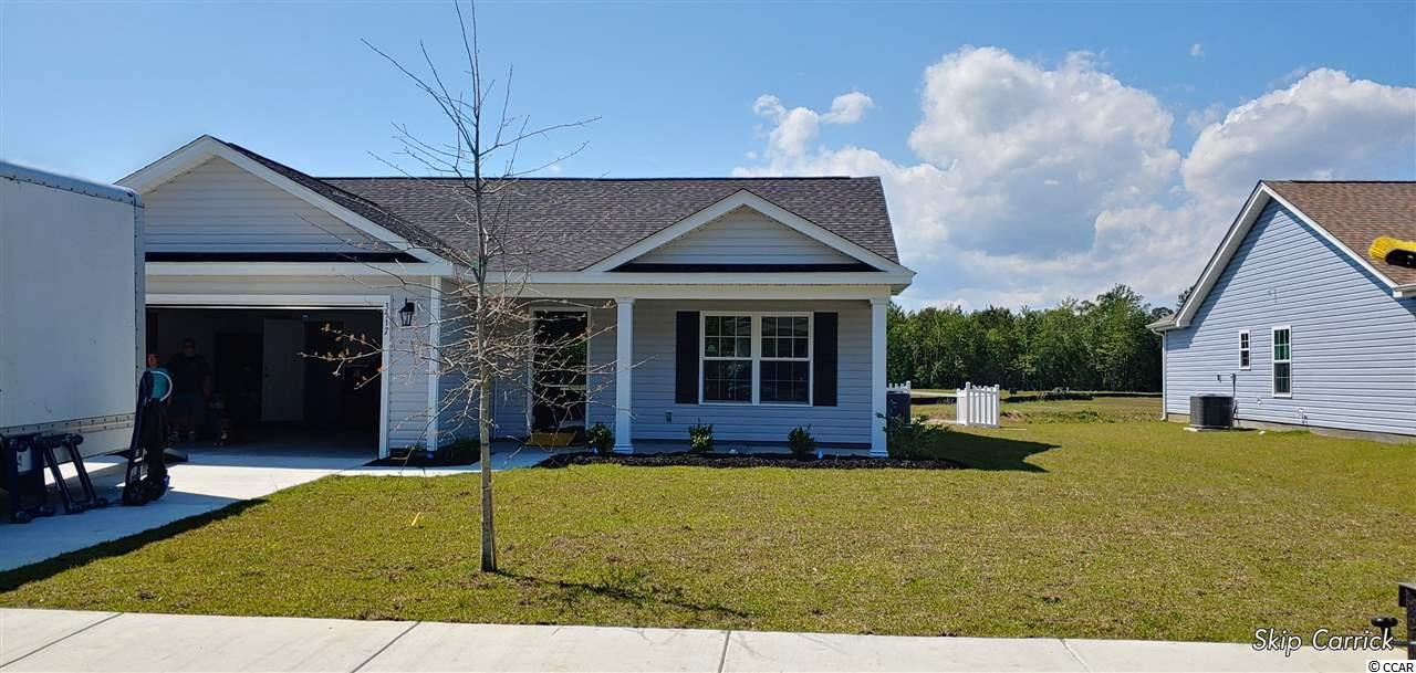 "Beautiful Busbee Plan in The New Woodland Lakes Community in The City of Conway, SC. Plan offers all of the right features and benefits.  Features include but are not limited to 3 Bedrooms 2 Baths, 2 Car Garage, Granite Countertops in Kitchen,Great Open Floor Plan, Vaulted and Trayed Ceilings, 2 Ceiling Fans, Plant Shelf, and Vinyl Windows, Plans also include Separate 10x14 Concrete Patio, Sidewalks to Front Entry and Driveway. All of the Homes in Woodland Lakes Community come standard with the luxury of a Tankless Hot Water Heater, Gas Heat, Gas Stove and Oven. These new Homes also include 36"" Profiled Kitchen Cabinets with Top Molding Trim and Door Knobs, Stainless Steel Appliances, Kitchen Pantry, Linen Closet, Completely Trimmed and Painted Garage with Drop Down Storage Access, which is Floored for your convenience, and Electronic Garage Door with Remote Openers. ""Low E"" Energy Efficient Windows, Upgraded Insulation Package, Landscaped, Sodded Yard, and so much more.  All of the homes in Woodland Lakes are built with a ""Maintenance Free"" Lifestyle in mind. Woodland Lakes is South Conway's Newest Community conveniently located near Shopping, Medical Offices and Hospitals, Restaurants,  and Schools. The Builder DOES ALLOW CUSTOM HOME CHANGES ON PRESALE HOMES!  Call or visit us online today and find out why This Builder is The Areas Premier Local Builder! Other Floor Plans, Inventory Homes and Custom Plans are Available. Call the Onsite Model for New Homes Availability and to make an Appointment to see Woodland Lakes."