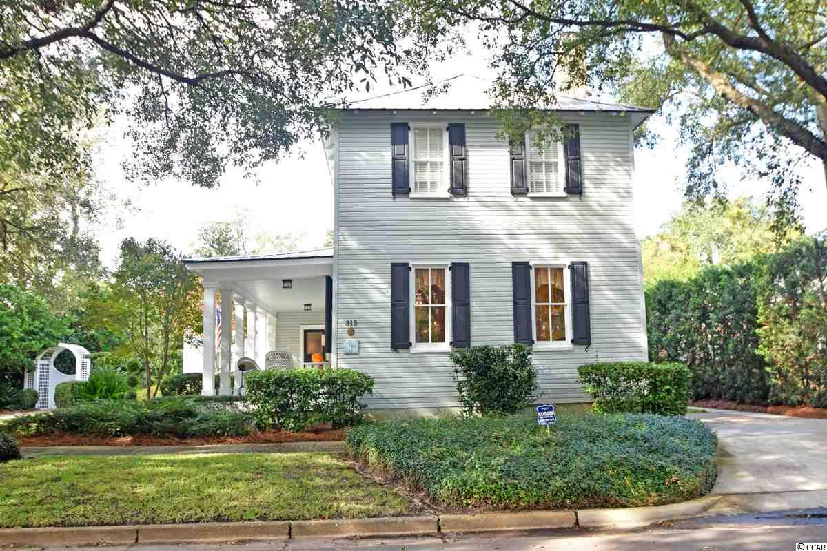 """Welcome to Queen Street in Beautiful Georgetown, South Carolina.   This Circa 1780 house was fabulously restored in 2007 while paying careful attention to the wonderful 18th century structure and marrying it seamlessly with the newer addition.  Craftsmanship is apparent as you venture from room to room with ease.  The home features formal living and dining rooms,  3 bedrooms, 2 full baths , a half bath , 5 fireplaces outfitted for natural gas logs, and a  sun filled den.  Heart of pine floors are thru out.  The """"chefs kitchen' is appointed with custom cabinetry and a wonderful walk in china closet.   A paneled study and a master suite are also located on the main floor.   The property also includes a two car attached garage and outdoor storage building.   With ease of flow, this home is ideal for the entertainer, with many rooms opening onto the terrace and porch.  Mature gardens create an oasis in the city! Listed with Carriage Properties of Charleston, Judy Tarleton."""