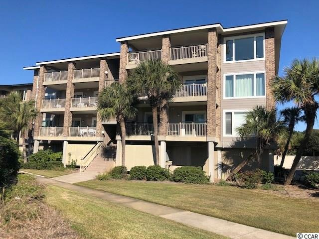 """Don't miss out on your opportunity to own a whole unit at Exclusive Pawleys Pier Village, the only Condominium housing on Pawleys Island Beach. Step into this Private Gated Community and start enjoying the Beach Life!  Location is everything and you won't be disappointed with this 3rd floor 3 BR 2 Full bath unit with Breathtaking Ocean Views and Peek views of the Creek from the Main Living Area Balcony & Ocean view from Master BR Balcony. Wake up to sound of the Ocean while you enjoy your morning cup of Coffee. Stroll out to the Beach and take in a magnificent Sunrise or Sunset at the only Private Pier Located in all of Pawleys and Only open to Pawleys Pier Village Residents. Enjoy day or evening of fishing on the Lighted Pier that includes Cleaning Stations, Bait hold tank, & Seating for just relaxing. Check out the Catch Board and add your name when you land the next """"Big One""""! Meet your neighbors & guests while you Lounge by the Pool w/ Private Club House, just steps from your Condo. Join a friend at one of the 3 boat Landings on Pawleys after you hook-up your Boat at the Private Boat Yard on sight. No lugging Groceries upstairs, just use the Elevators. You'll appreciate the convenience of covered Parking and Storage under your unit and a Garbage Chute in the Hall outside your front door! The Condo meets all you need for vacations/ rentals, or full time use. Free flowing floor plan with Over-sized Tile and Wood Flooring in the Living room and Kitchen. Serve Breakfast on the Balcony with accesses thru both the Kitchen and Family room. Enjoy a Mimosa at the Breakfast Bar that includes extra overhead lighting or binge watch your next Netflix series in the cozy Family room. The Kids and your guests will love the 2 guest BR's with Built-in shelving, Full Hall Bath w/tub, and Counter Height Vanities. Both the Master BR and the larger Guest BR have an additional Vanity with Sink & the Master BR has it's own on-suite bath. The Condo sports a Laundry room with Full Sized """