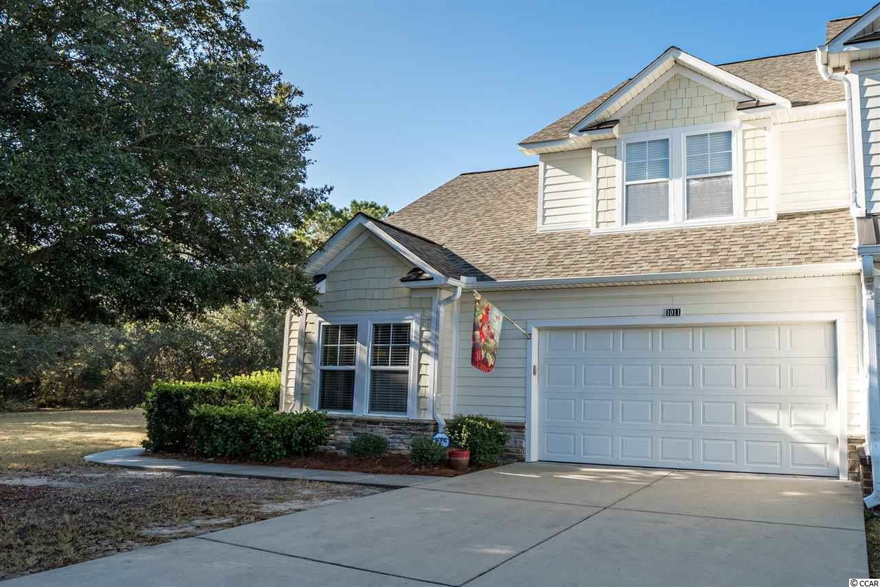 """If your looking for privacy, here is your opportunity. This townhome is located in the Tanglewood section in the prestigious Barefoot Resort & Golf. With over 1,800 heated sq. ft. and a private 2 car garage located between the 11th and 13th holes of The Norman Course, this home has been completely remodeled with 42"""" wood cabinets, with a custom built wine rack, granite counter tops, stainless steel appliances and 18"""" tile floor in the kitchen. The living area has architectural hardwood flooring and custom banister and metal railing on the staircase and loft area. Enjoy your morning coffee or evening dinner on the screened porch with slate floors and sunshade with views of the Norman golf course. With the HOA approval, there is a motion light on the side entrance for additional illumination. The 2 storm doors have pulled down screens. For the golfers, there is a TRANSFERABLE GOLF MEMBERSHIP, with a small fee to Barefoot Golf and Resort. Included in the HOA dues is access to the new beach cabana and the 15,000 salt water pool located on the ICW in addition to the community pool in Tanaglewood."""