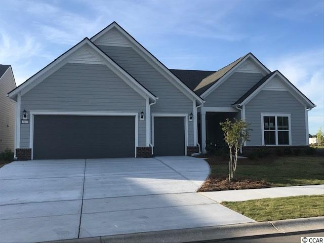 Dunwoody Floorplan, Single level, 3 bedrooms, 3 bathrooms open floorplan with indoor fireplace and an office. 2 car extended garage and additional bay for golf cart storage.  Large screened Lanai and Patio/outdoor space.  Natural Gas Community. Water view homesite!