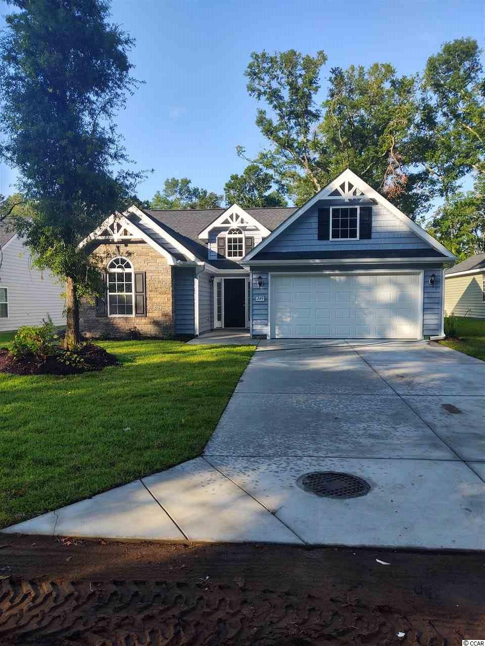 This is the Wando plan with 3 bedrooms and 2 baths, stacked stone accent and screen porch. Granite counter tops and stainless steel appliances in kitchen. Luxury Vinyl Plank Flooring thru entire house. No HOA so privacy fences and boats are allowed. There are many prestigious golf courses just minutes away and also Brookgreen Gardens, Huntington Beach State Park and the Murrells Inlet Marshwalk. There are only a few lots left and you don't want to miss out on this opportunity to live just minutes from the beautiful Litchfield and Pawleys Island beaches!!!