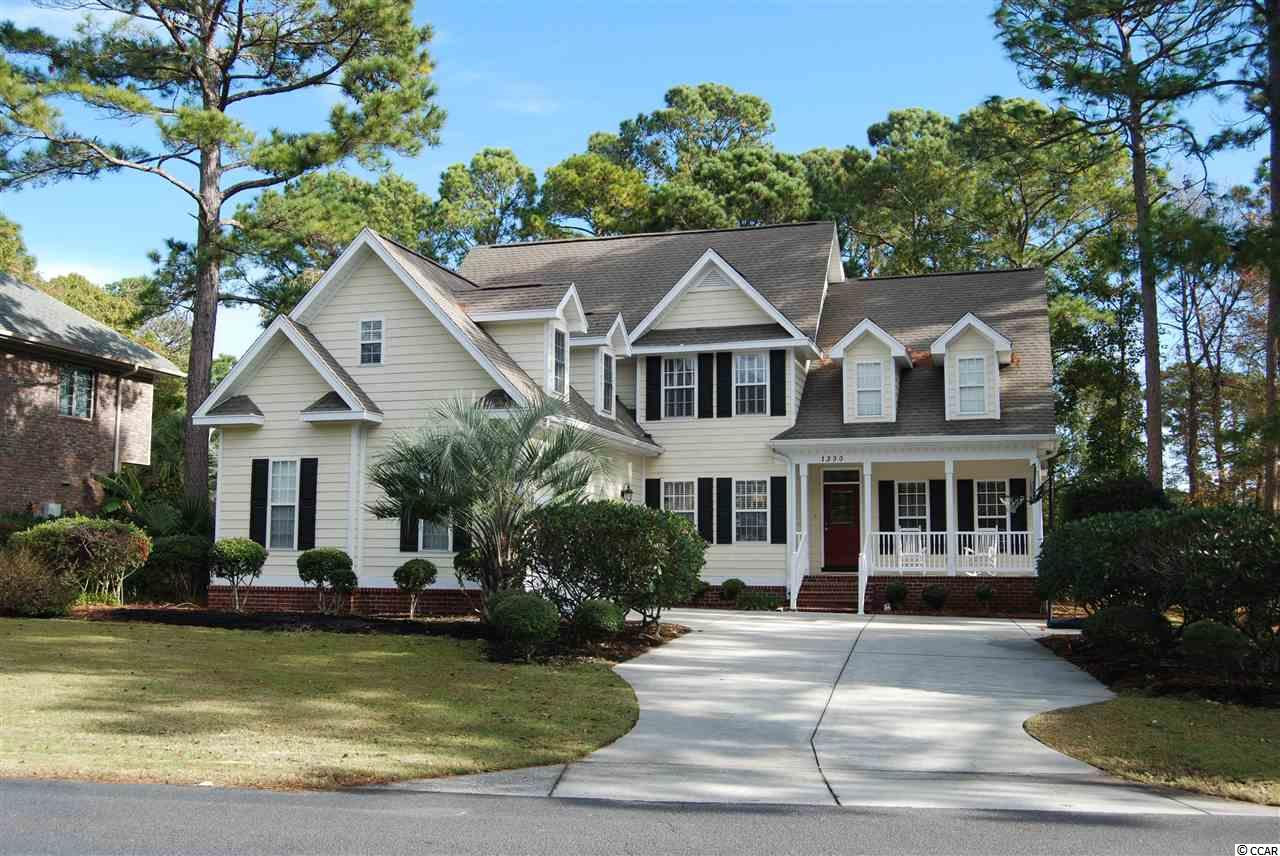 Stunning Low Country Beauty with Gorgeous Golf Course Views! 5BD/3.5BA 5th bedroom/Bonus Room. Spacious Open Great Room w/Fantastic Golf Course Views of #3 Green, Hardwood Flooring, Gas Fireplace & Custom Built In's. First Floor Master Suite w/Golf Course Views, Tray Ceiling, Custom Walk In Closet, His & Her Vanities/Sink, Jetted Garden Tub & Walk In Shower! Light, Bright Open Kitchen w/Stainless Steel Appliances, Granite Counters, Work Island, Walk In Pantry & Spacious Breakfast Nook! Formal Dining Room features Accent Tray Ceiling & Butler's Pantry.  Den or Office w/French Door Entry. Enjoy Tranquil Golf Course Views from Beautifully Finished 14 X 31 Back Deck! Put This On Your MUST SEE List!  It will be a Pleasure to Show! Prestwick is a Premier Guard Gated Golf Course Community in an Excellent Location! HOA Fees Include use of Jr. Olympic Sized Pool, Cabana & Tennis Courts, Cable TV w/Premium Channels & Internet, Security Guards, Trash, Yard Debris & Recycle Pickup! Pete Dye Designed Golf Course within Community & Additional Tennis Stadium Membership Available. Award Winning Lakewood Elementary School & Access to the Beach through the Myrtle Beach State Park are both just 1/4 mile away. All. Sq. Ft. Meas. are Approx. & Not. Guaranteed. All Sq. Ft. Measurements are to be verified by the Buyer or the Buyer's Agent.***LSV Type Vehicles (Golf Carts) are Allowed.***