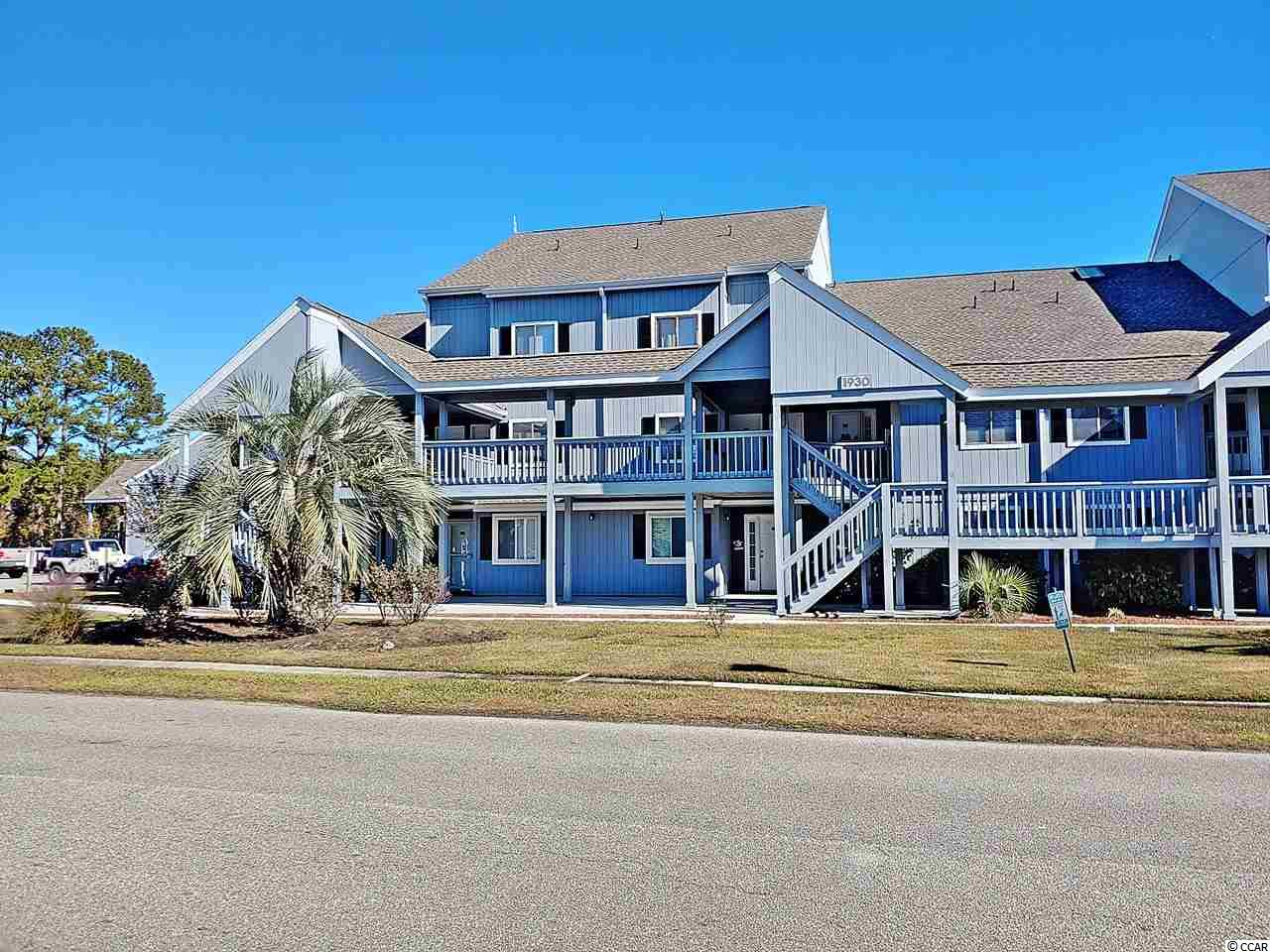 """This large 2br/2bth townhouse style designed condo with a beautiful """"beachy"""" flavor . The huge kitchen has newer frig, stove and a very large breakfast bar. You will see the pretty beach style flooring when you enter the condo. The 1st floor bedroom has 2 """"new"""" queen size mattresses. The lofted 2nd bedroom  can accommodate 2 queen beds also. The vaulted ceilings and (new)  skylights create the wide open floor plan. A 9' sliding glass door opens to a  sunny deck overlooking  the pretty pool and lounging  area.  Great gathering place , meet your neighbors. The courtyard also has grilling area for cooking out. There are 2 nice tennis courts for your enjoyment. Golf Colony has year round owners, as well as 2nd home vacationers .  So convenient to airport, beach, shopping and our Seafood Capitol  of SC Murrells Inlet fishing village.  Must see ."""